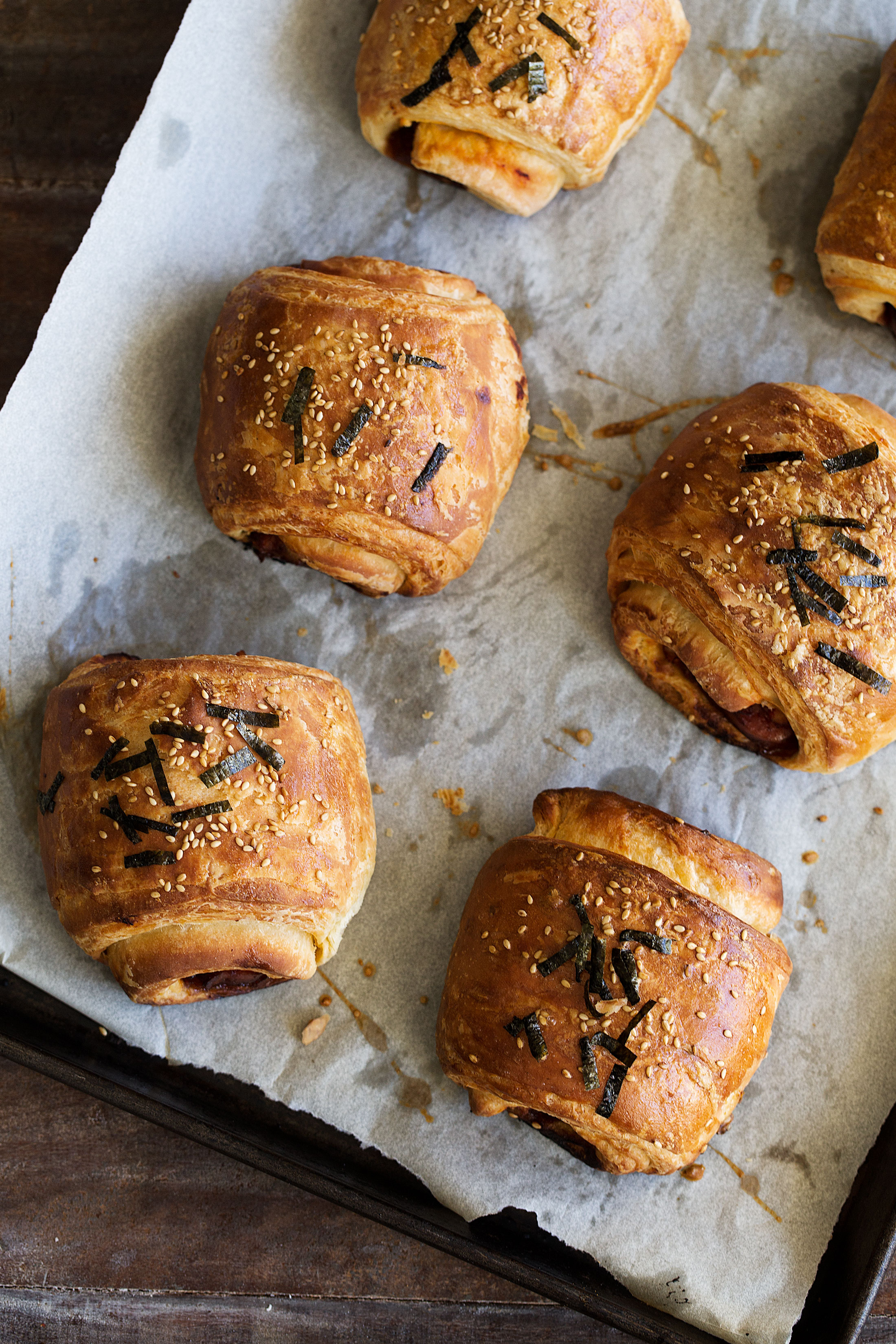 closeup croissants on baking sheet