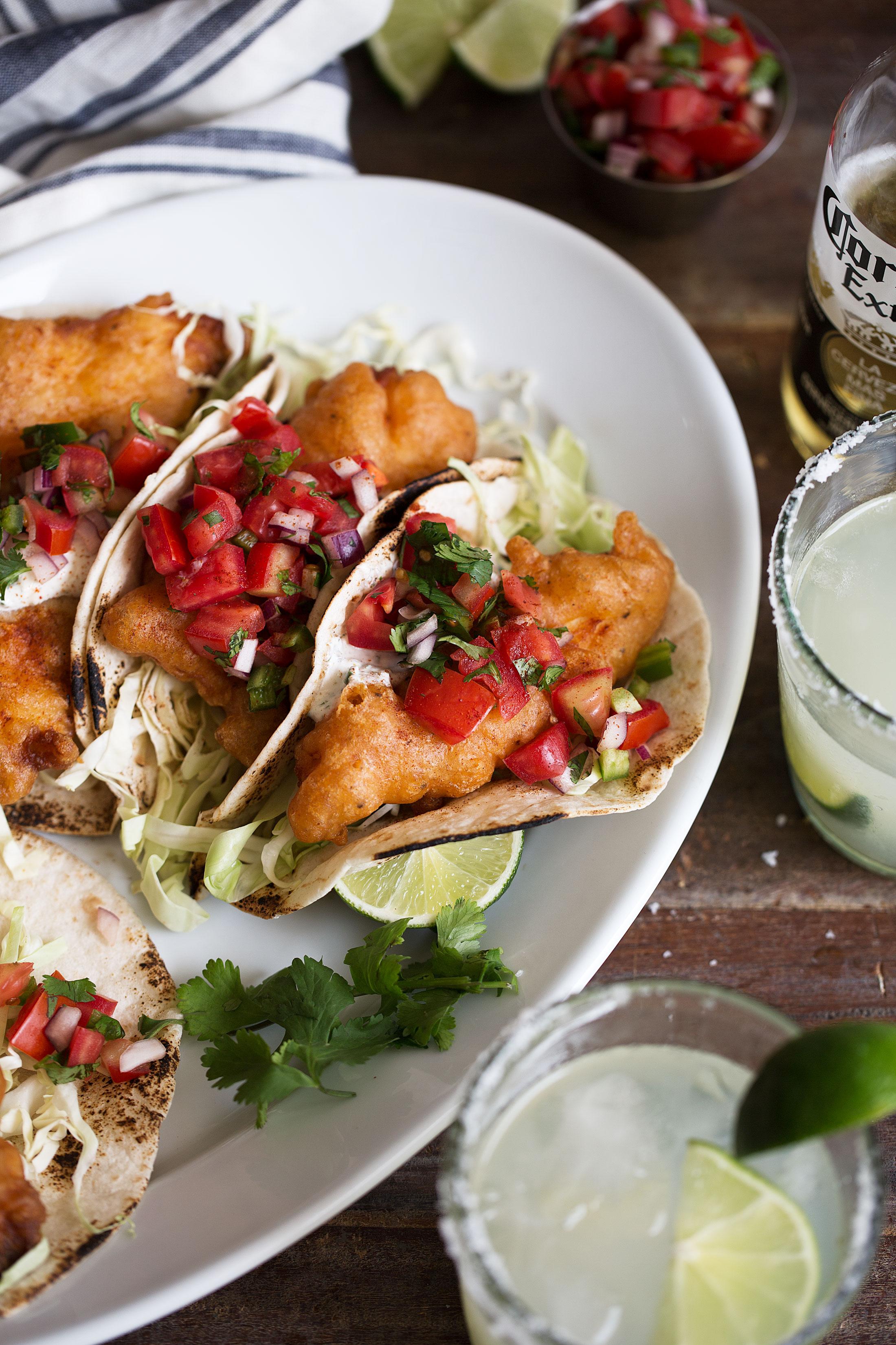 closeup beer battered baja fish tacos with herb yogurt sauce