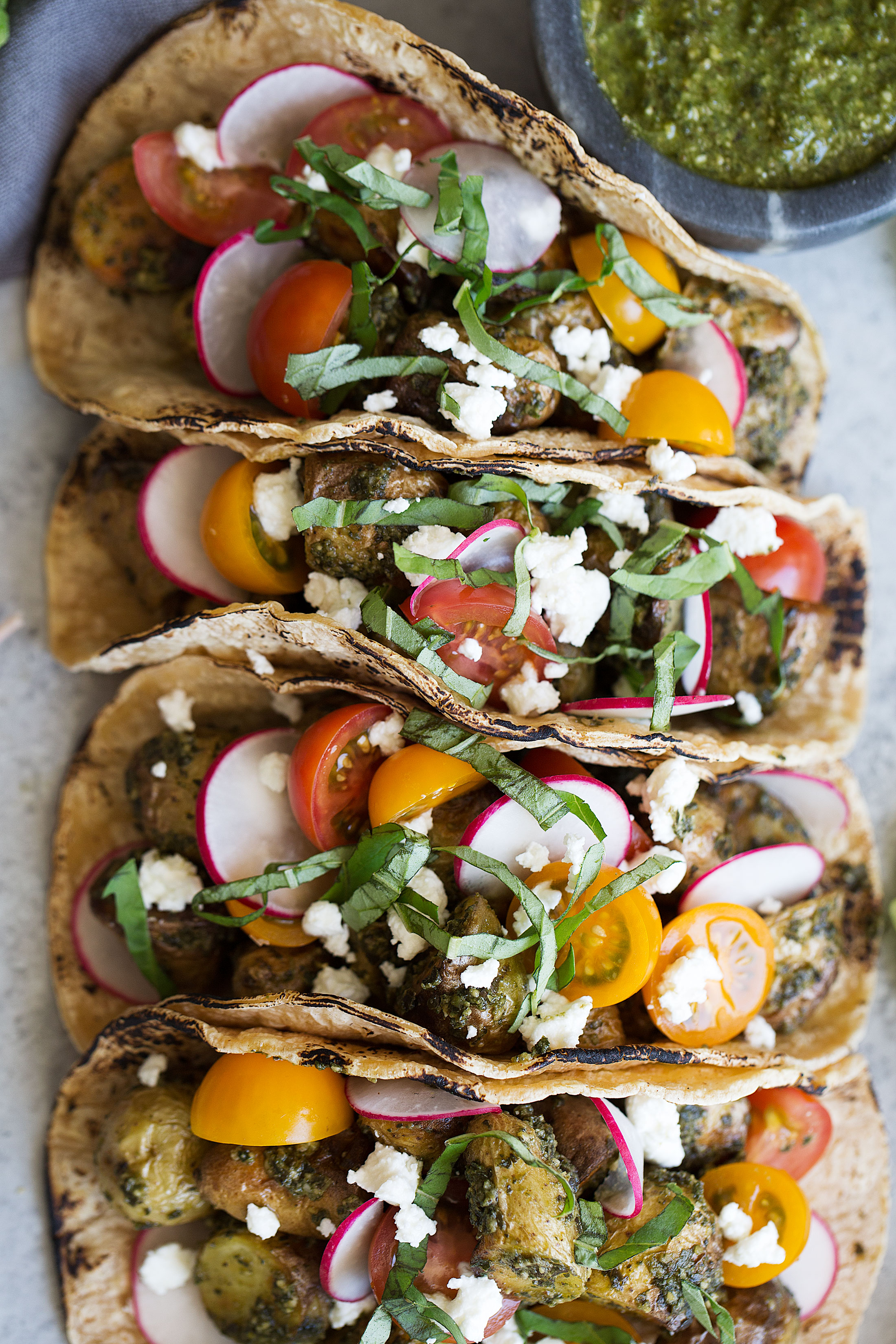 pesto potato tacos with goat cheese and cherry tomatoes