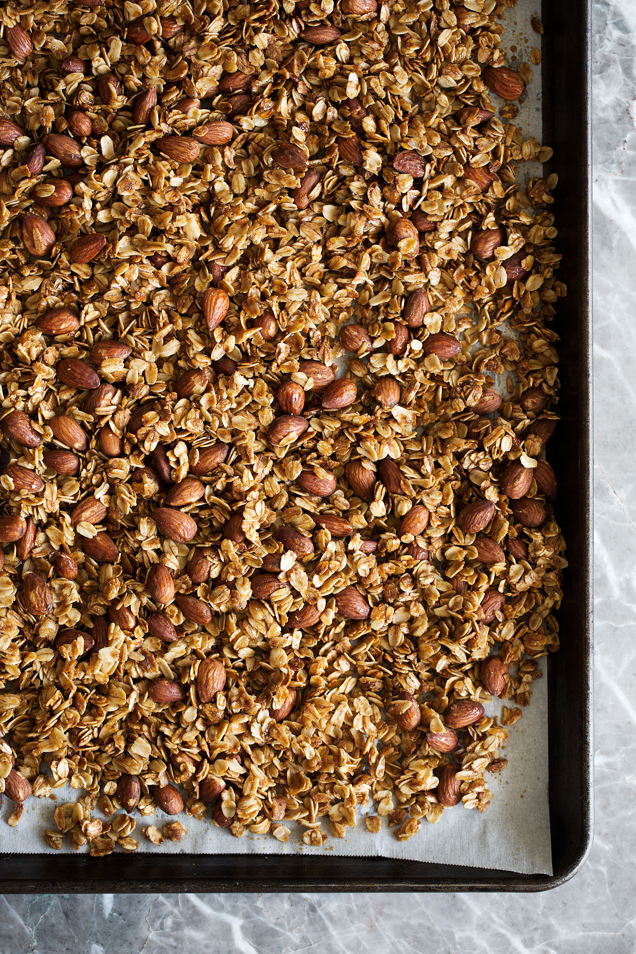honey almond granola on sheetpan