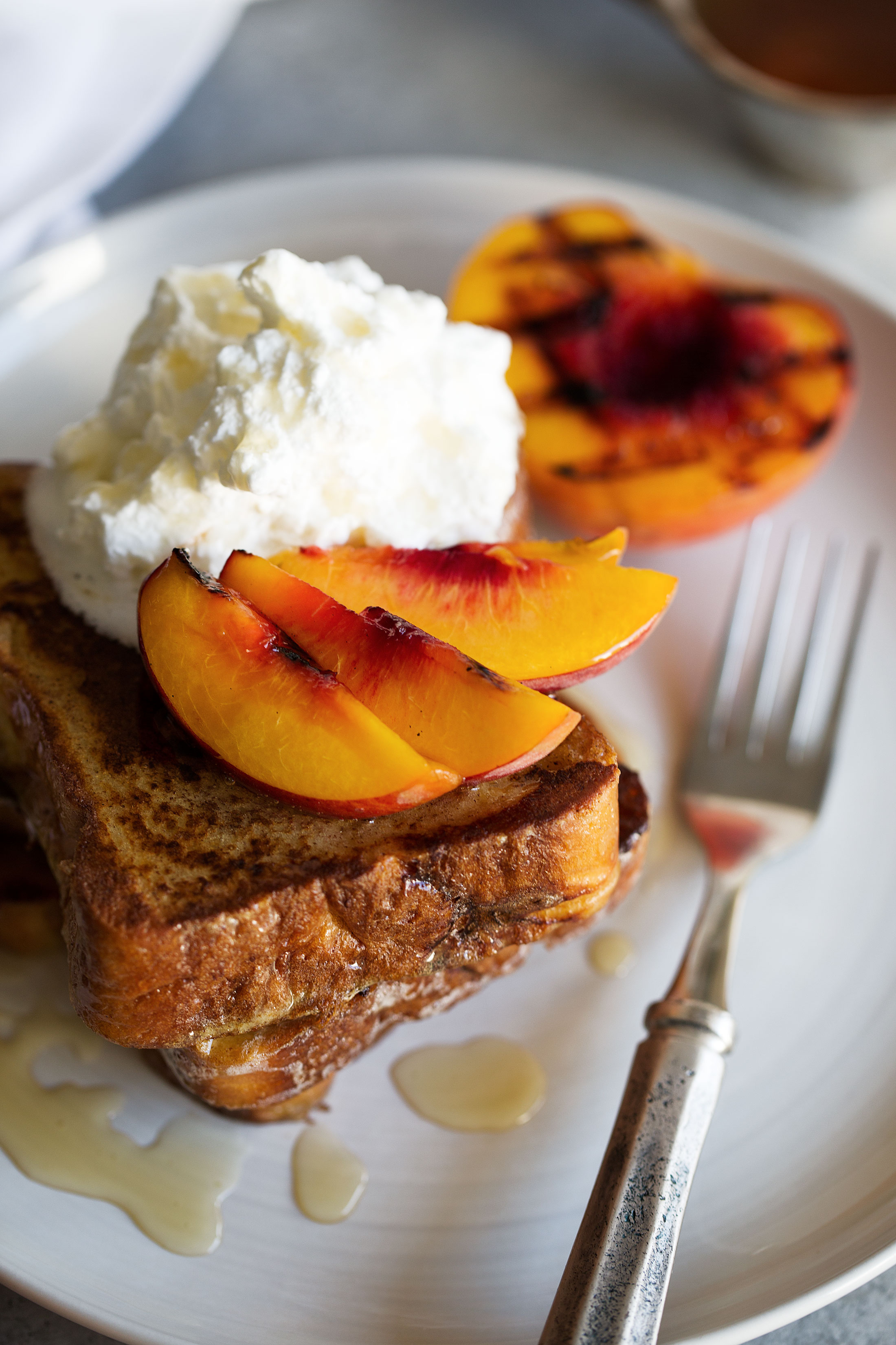 grilled peaches and cream challah french toast top view cooking with cocktail rings