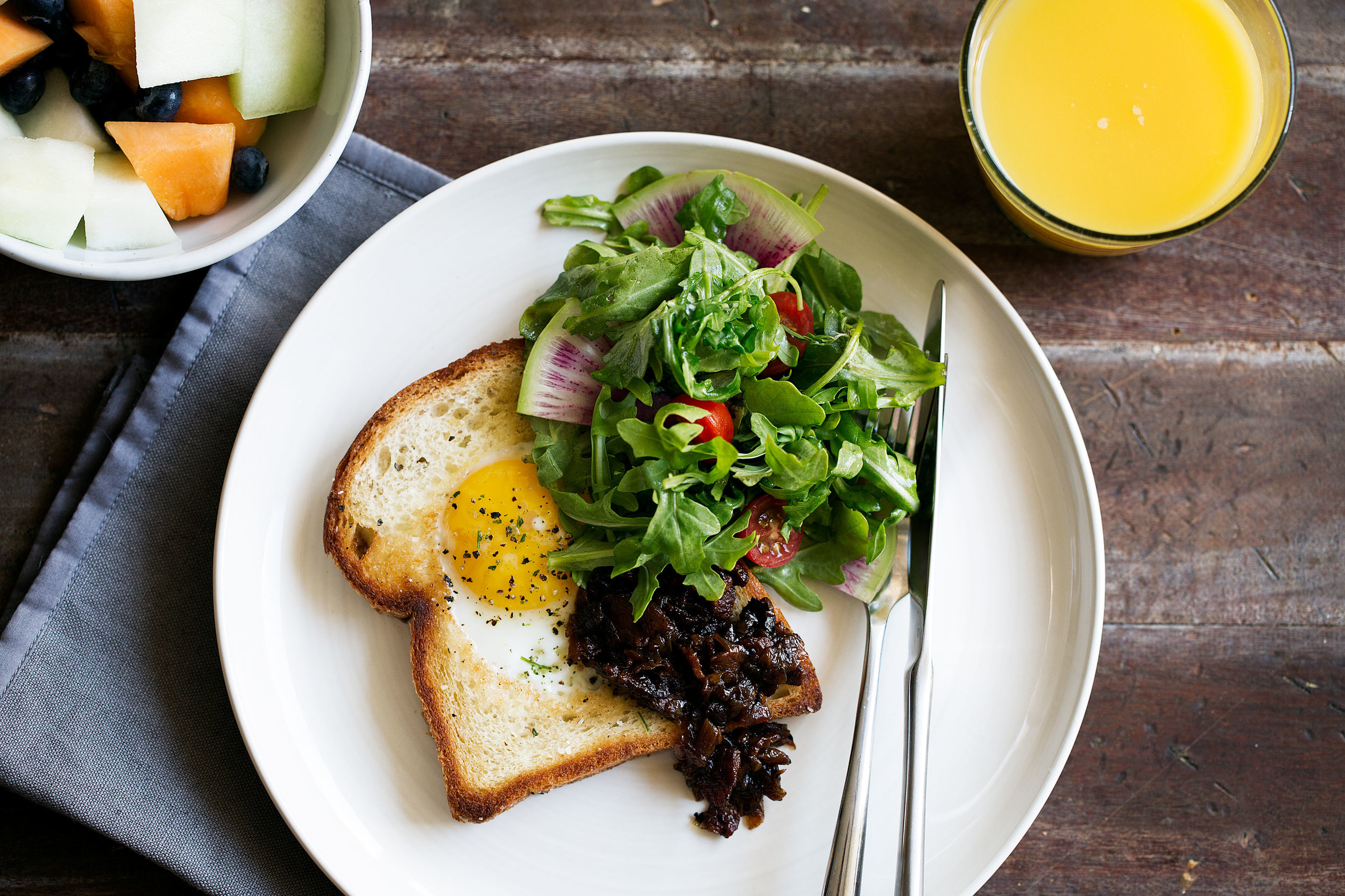egg in a hole brioche toast with bacon onion jam