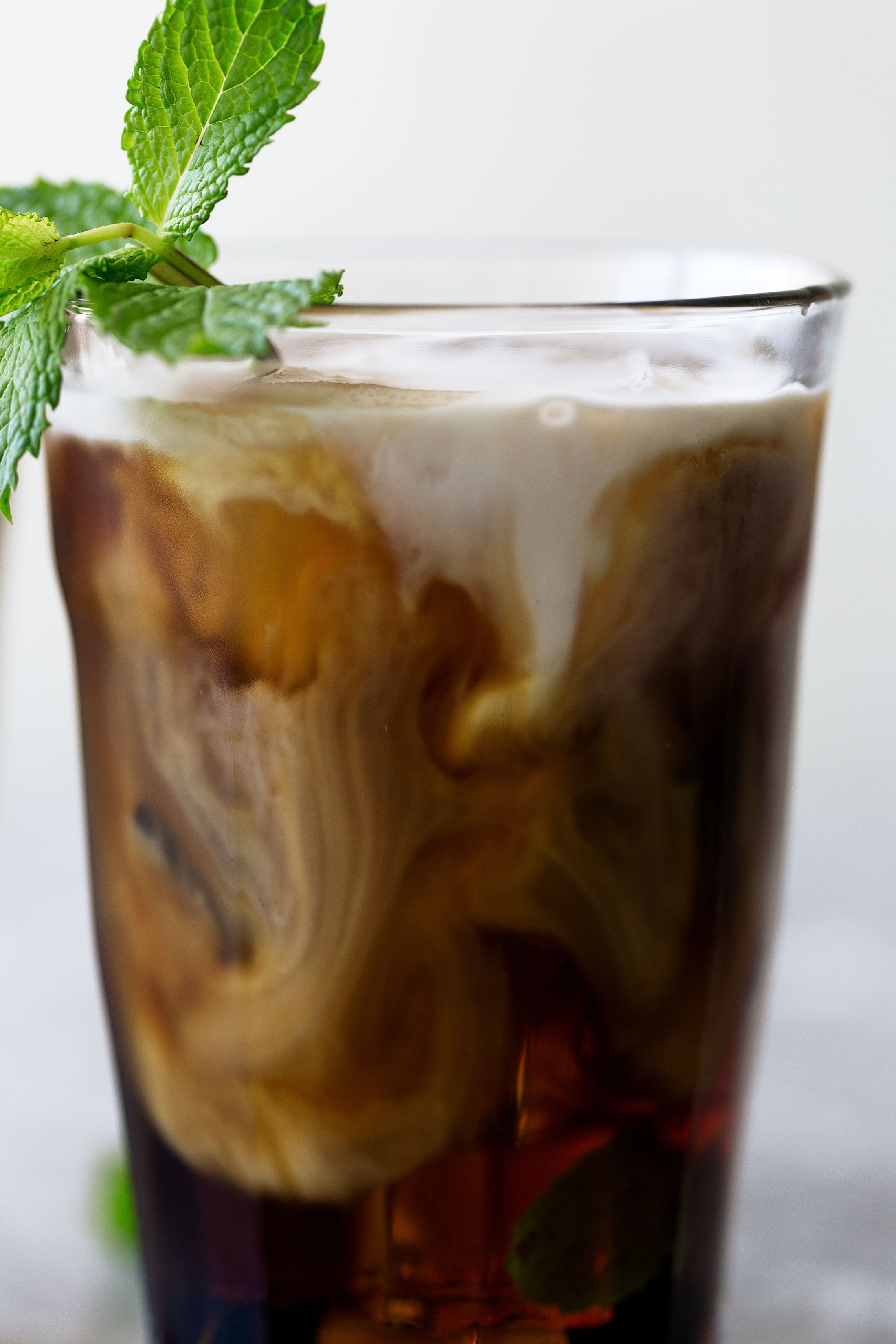 mint mojito iced coffee cooking with cocktail rings closeup