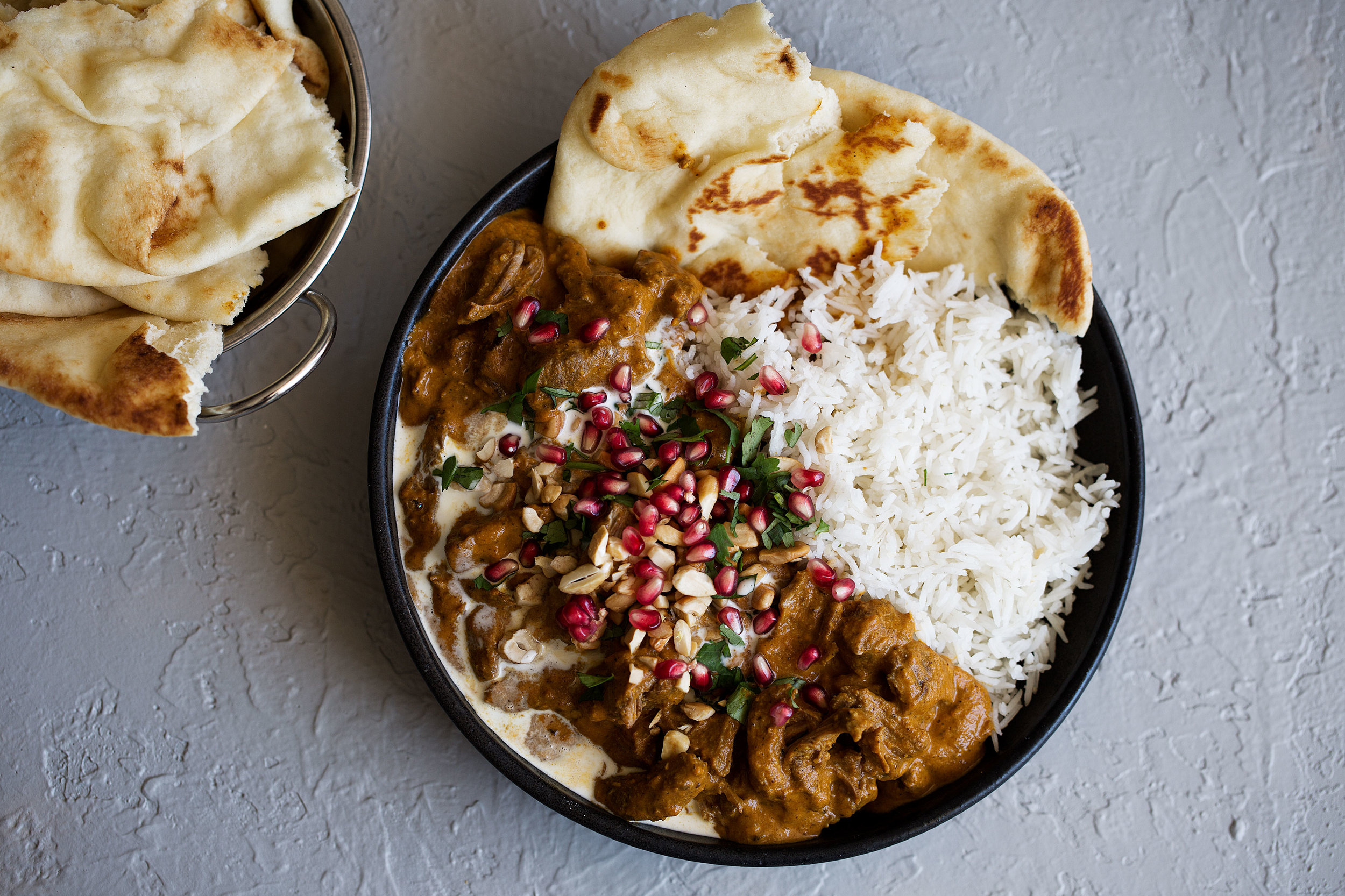 lamb korma cooking with cocktail rings