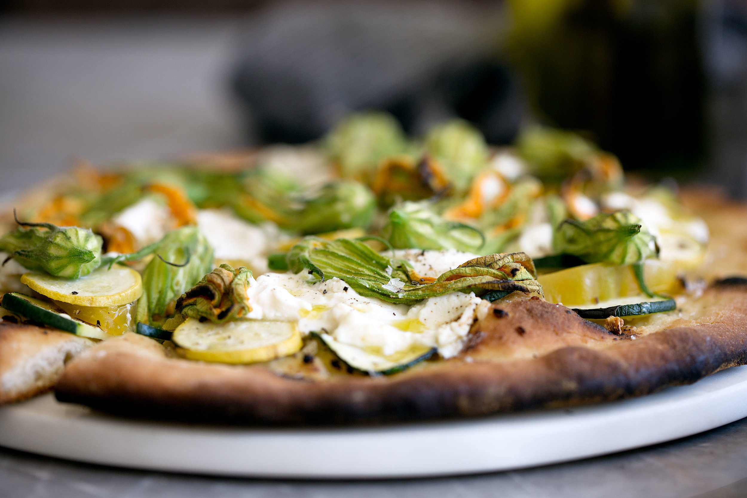 squash blossom and ricotta pizza with zucchini heirloom tomato cooking with cocktail rings