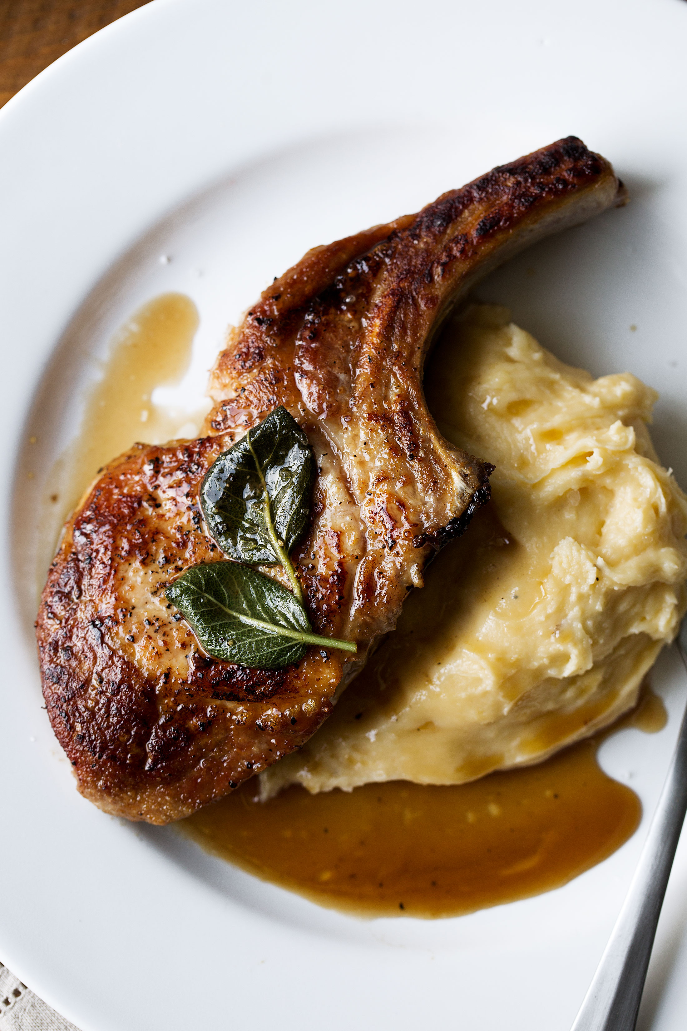 apple cider and sage glazed pork chops with whipped cheddar potatoes