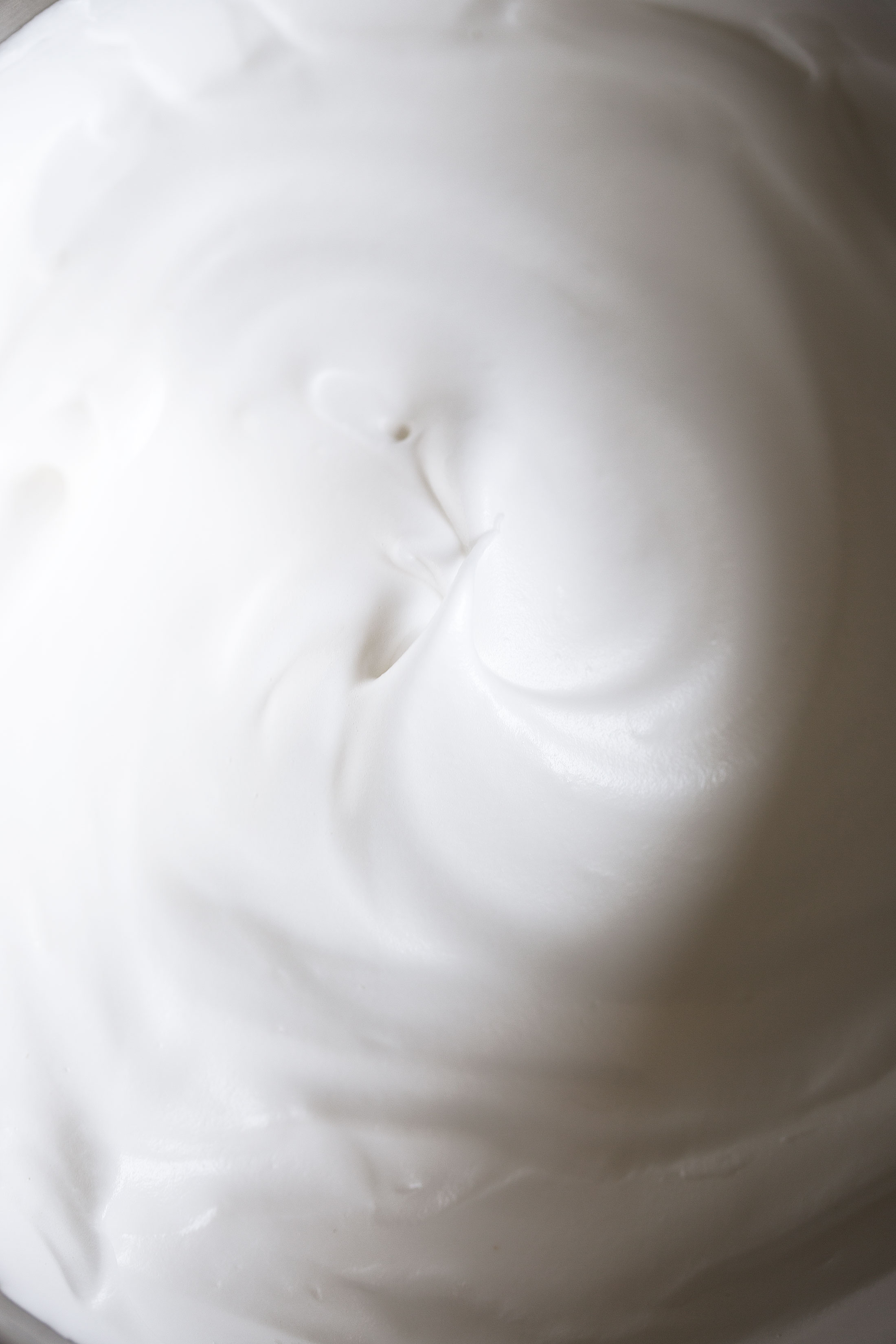closeup meringue cooking with cocktail rings