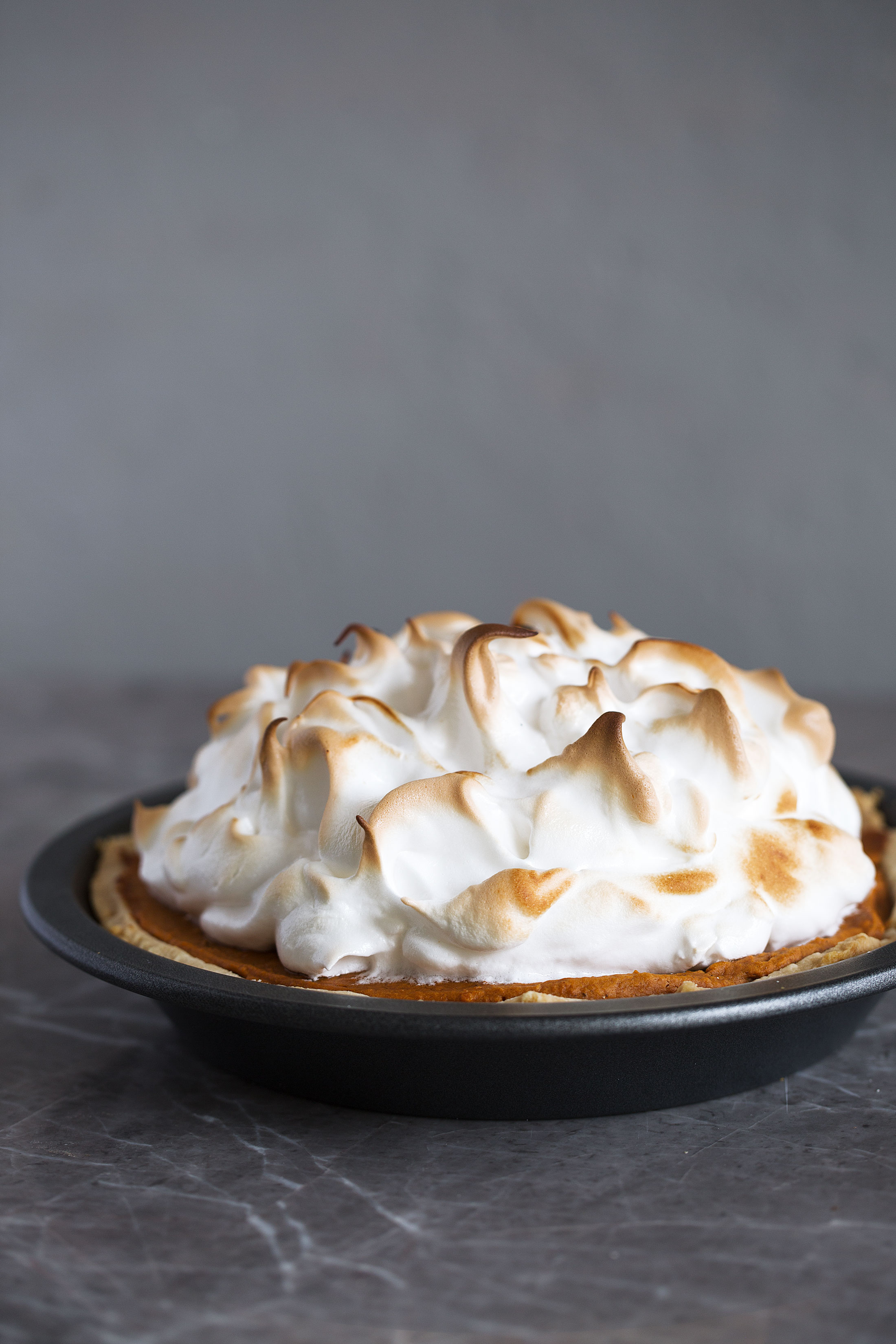sweet potato pie with toasted meringue topping recipe from cooking with cocktail rings side view whole pie