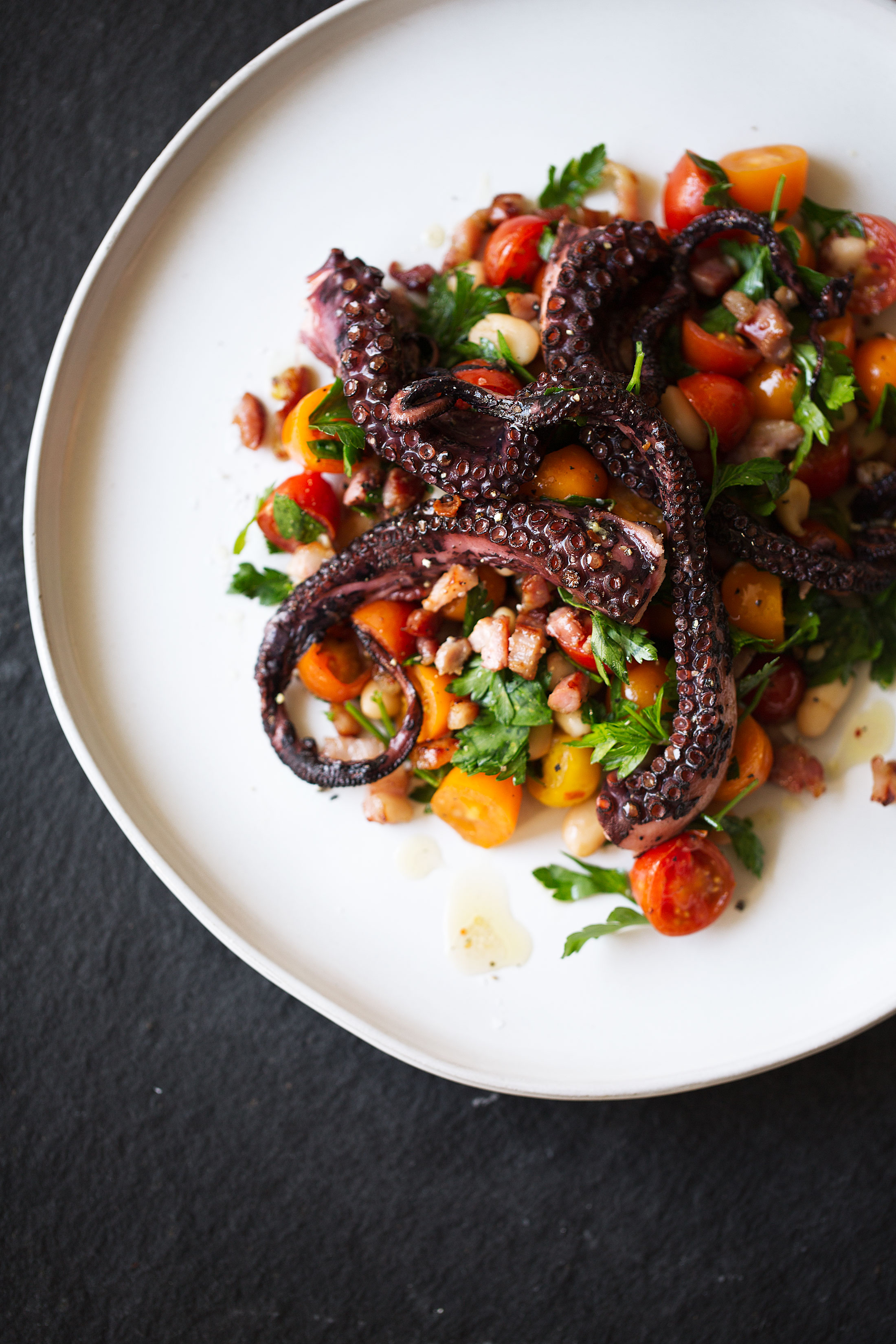 Charred Octopus with Warm White Bean and Tomato Salad and Guanciale Vinaigrette