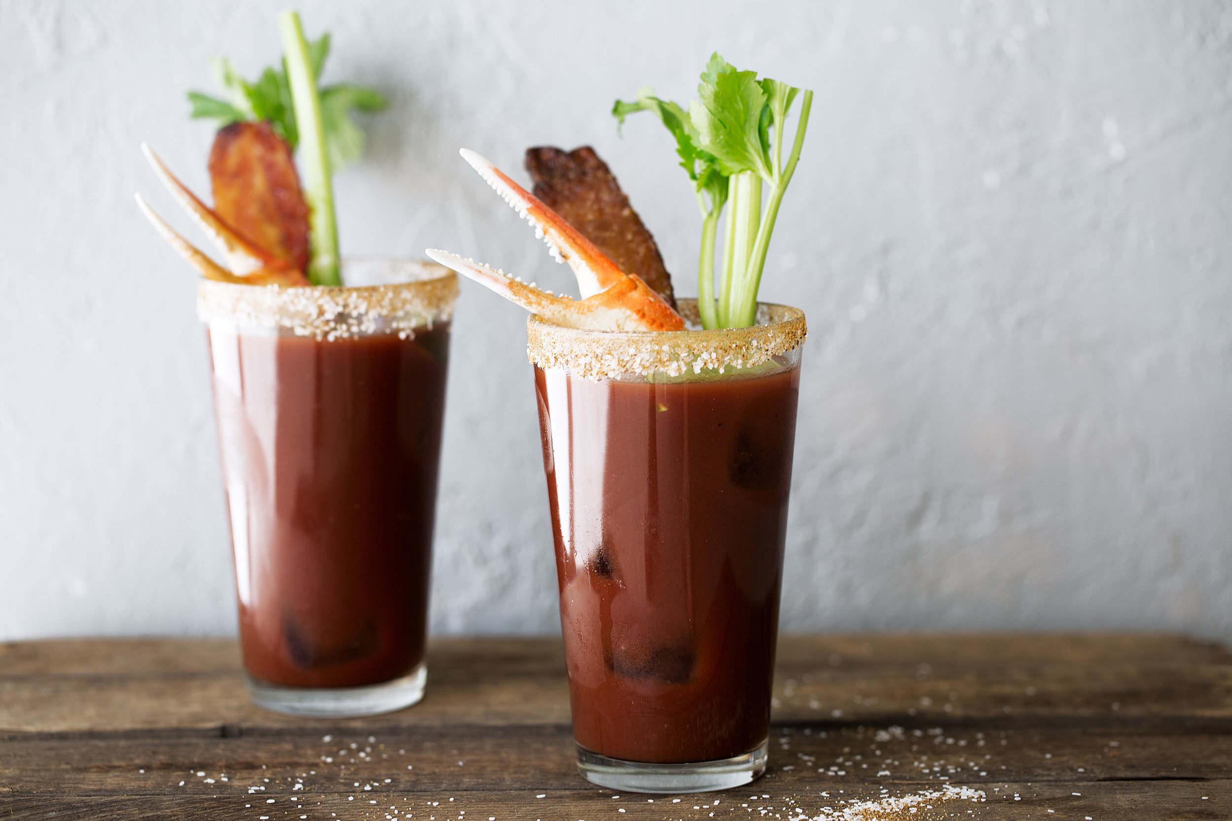 Loaded old bay bloody mary with candied bacon