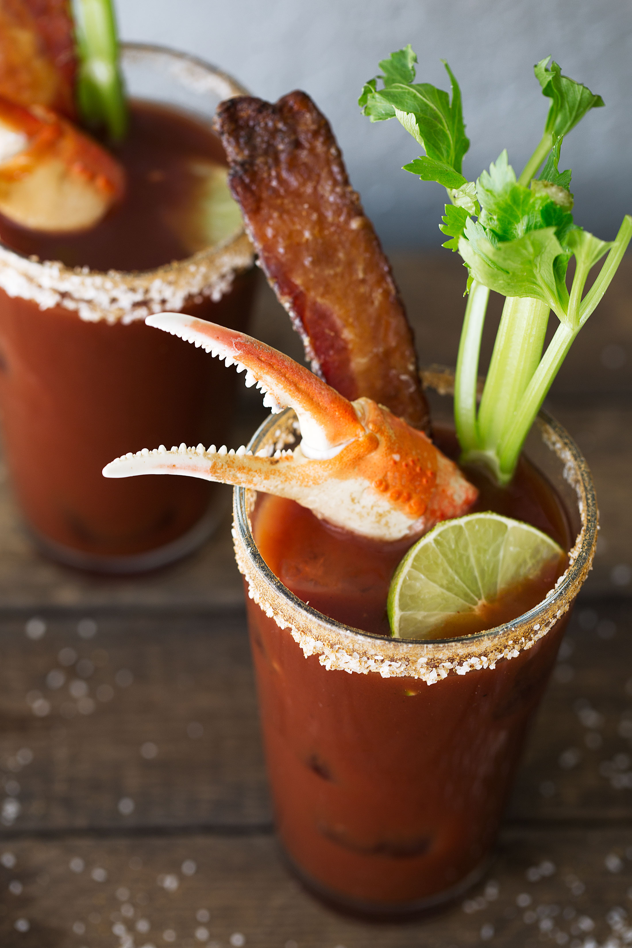 Loaded old bay bloody mary with candied bacon closeup