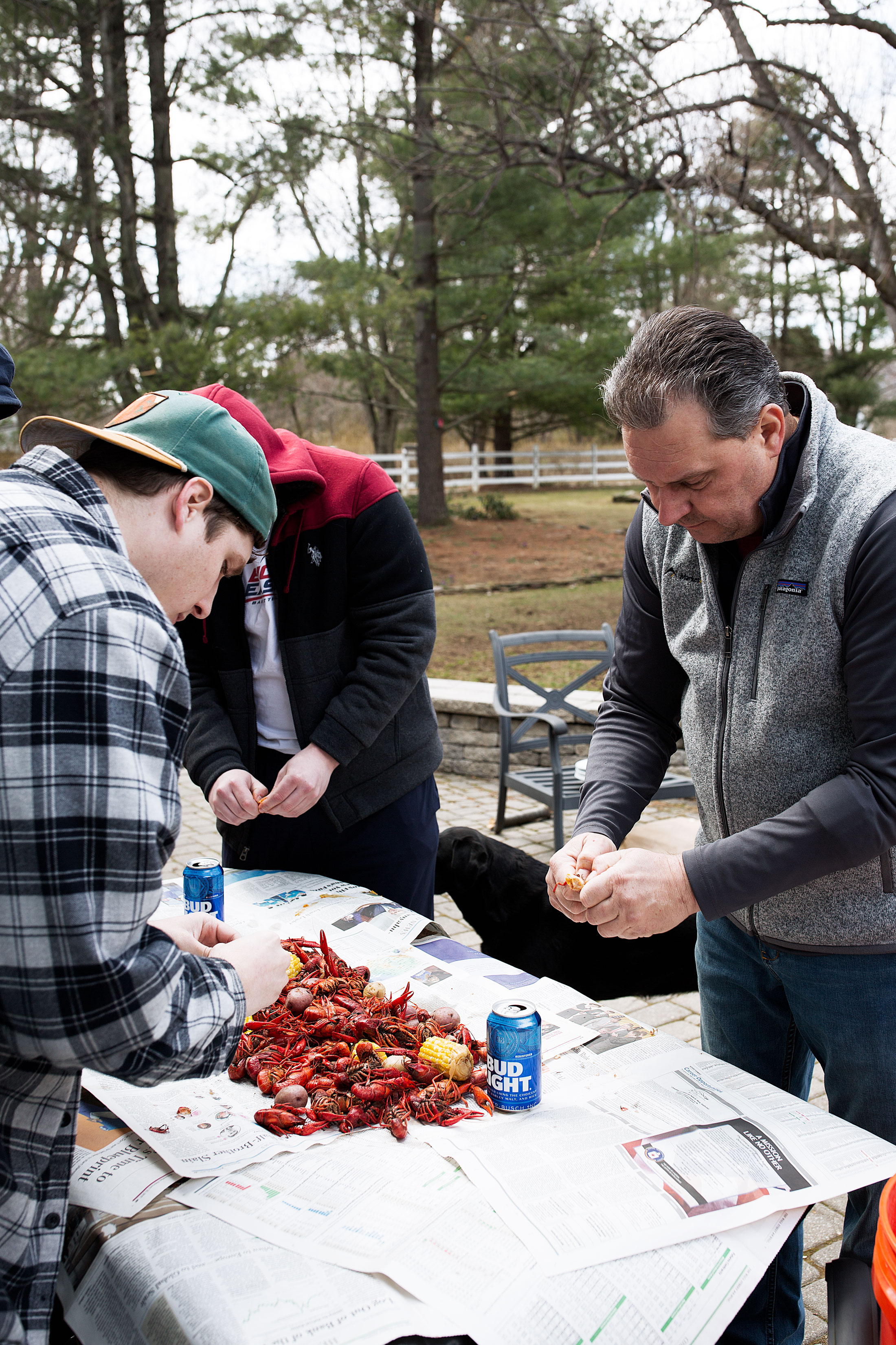 traditional crawfish boil with family cooking with cocktail rings