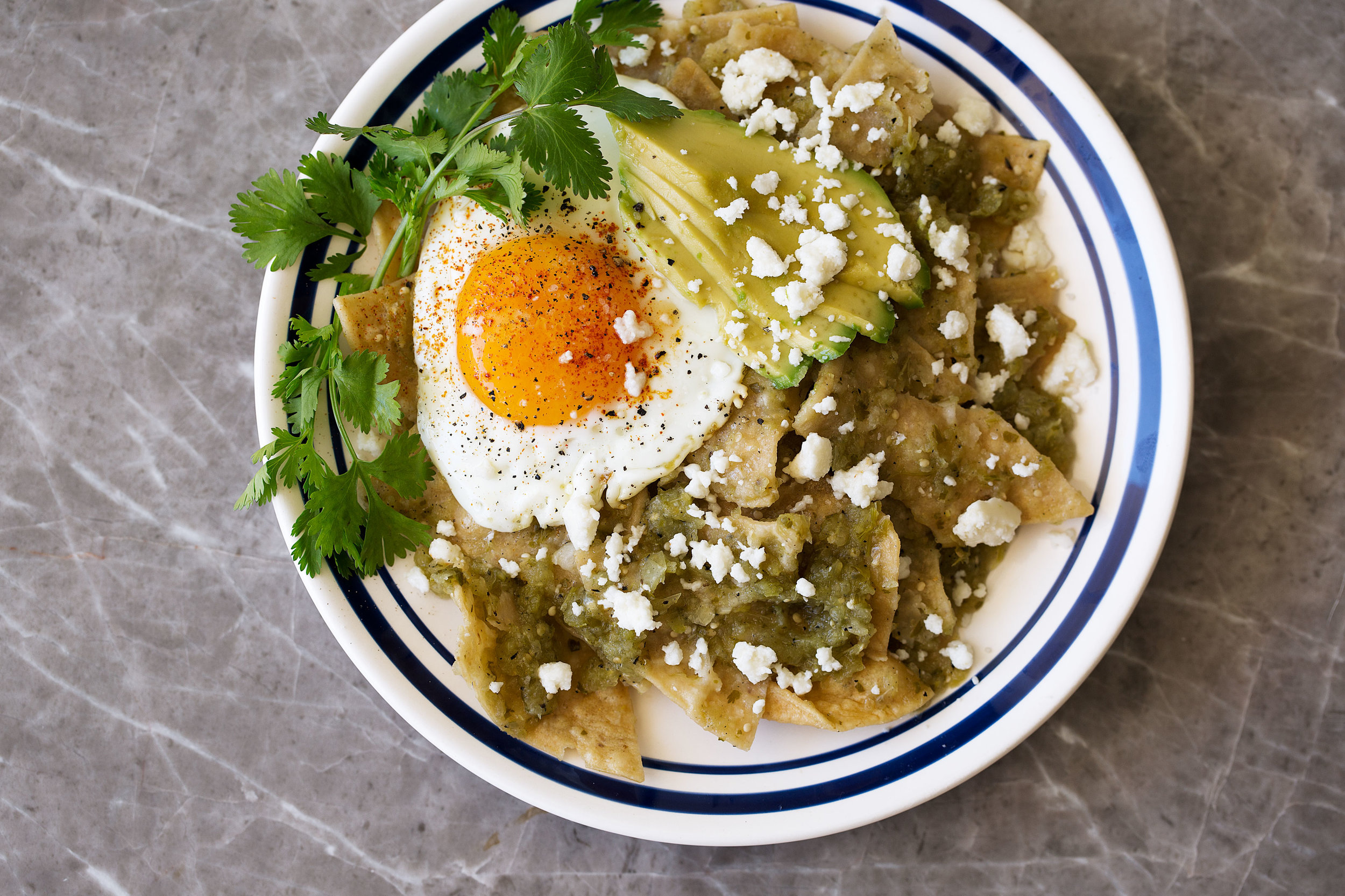 chilaquiles verdes with a fried egg recipe from cooking with cocktail rings