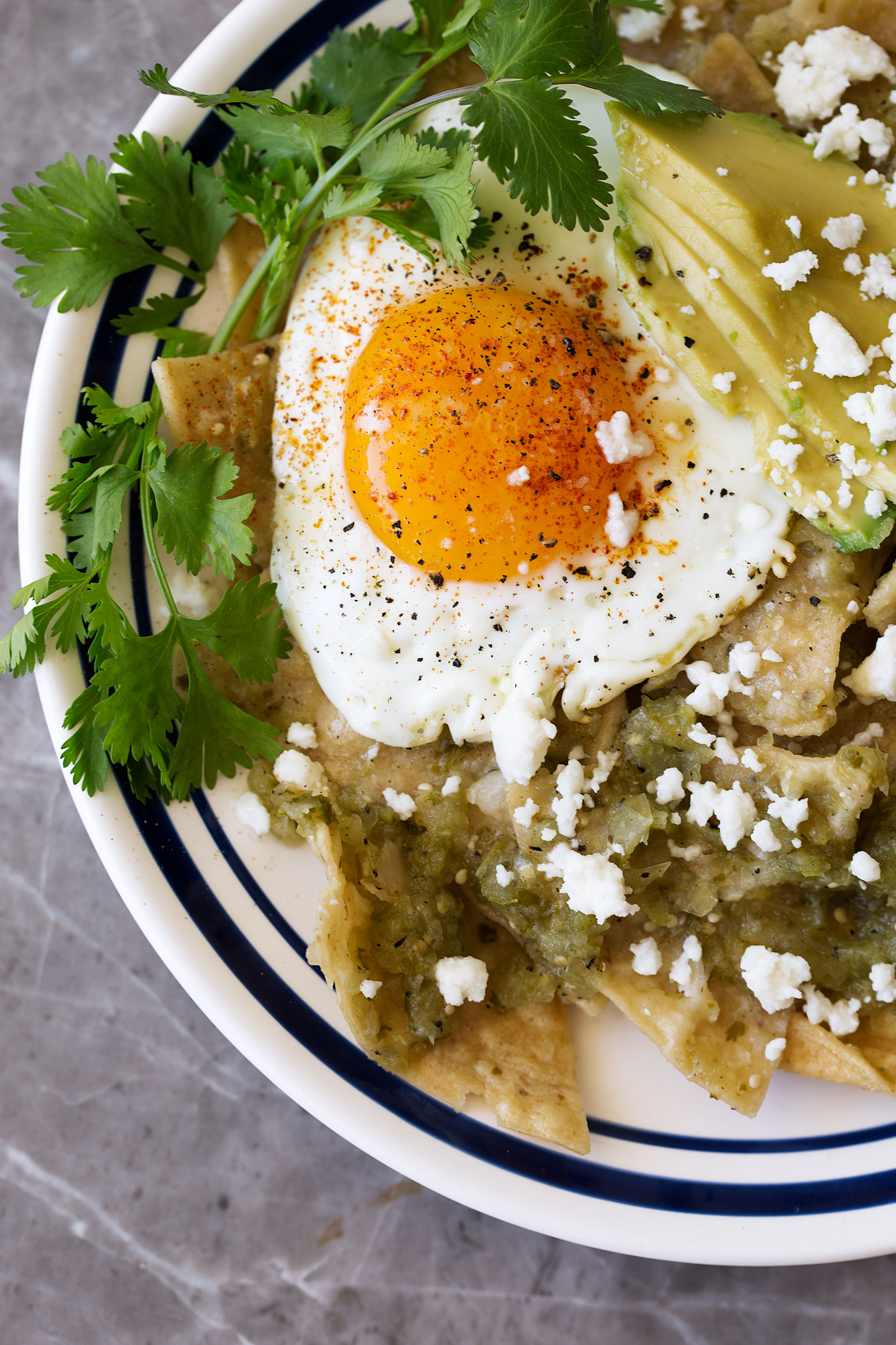 chilaquiles verdes with a fried egg recipe from cooking with cocktail rings closeup