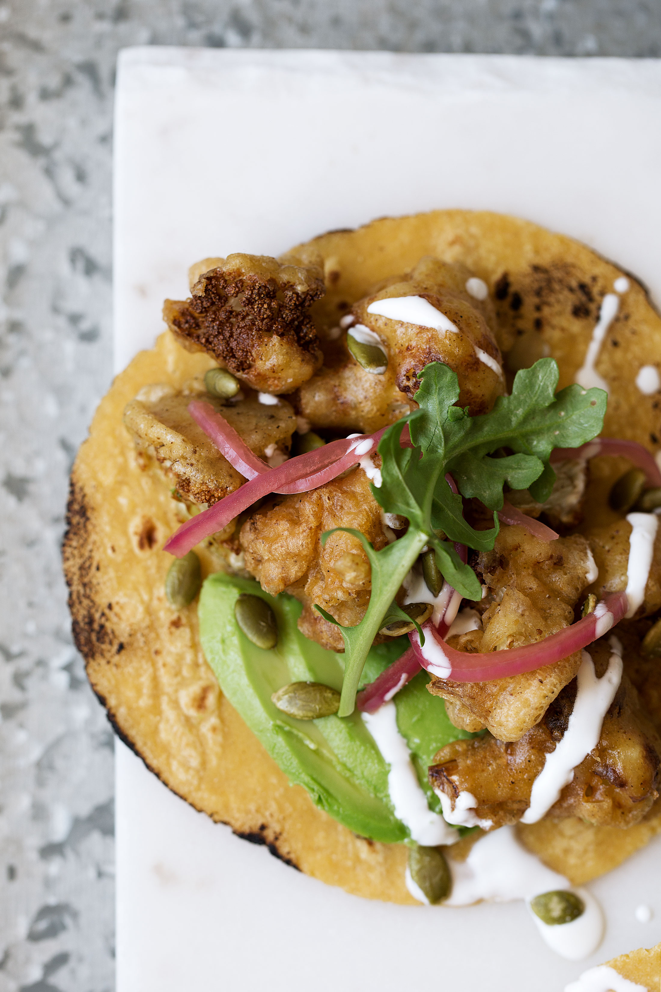 roasted cauliflower and avocado tacos recipe from cooking with cocktail rings single taco