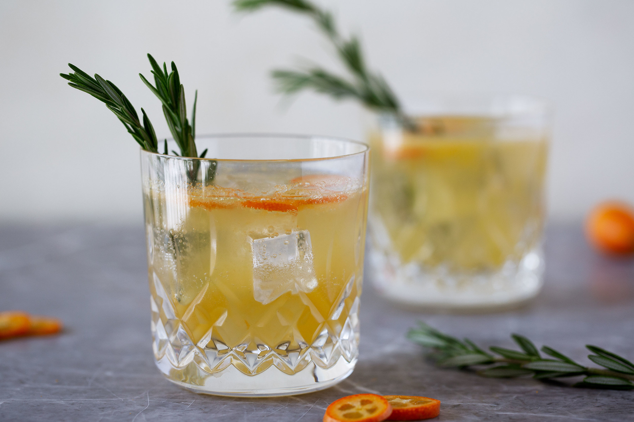 rosemary kumquat gin fizz cocktail recipe from cooking with cocktail rings happy hour