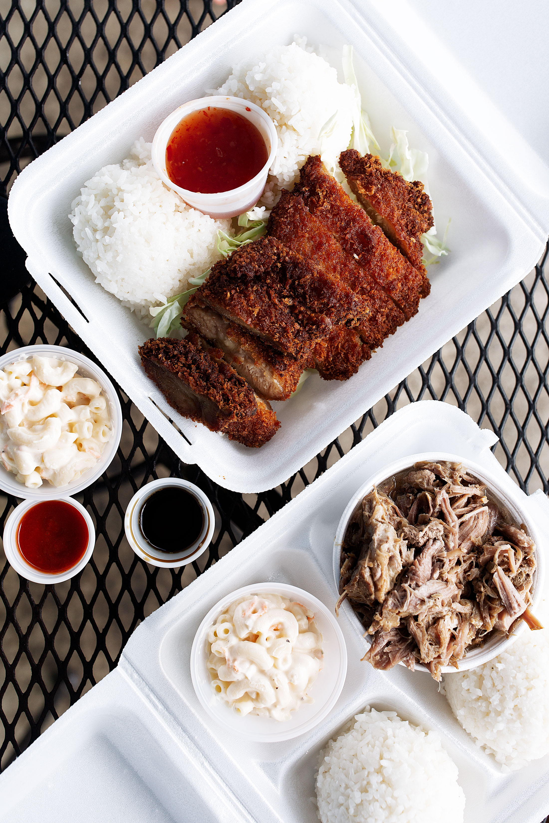 yama's fish market kalua pork and mochiko chicken cooking with cocktail rings travel hawaii