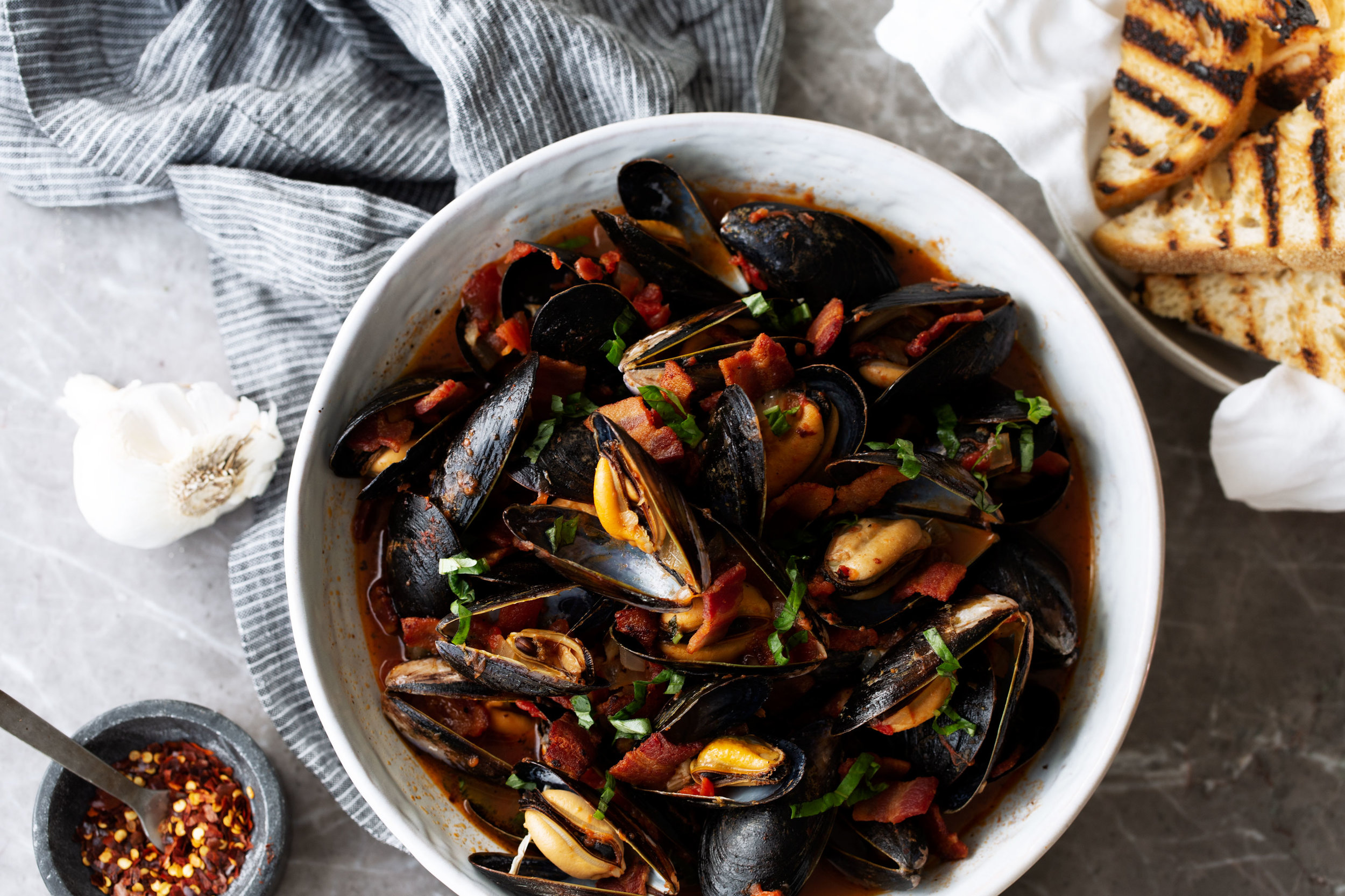mussels in tomato broth with bacon recipe from cooking with cocktail rings pomi tomatoes