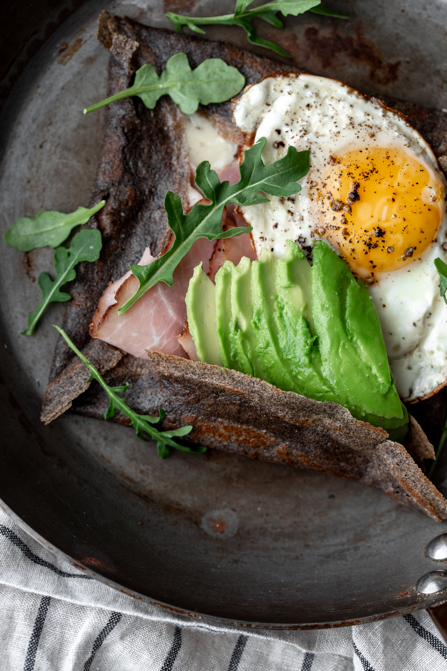 Buckwheat Crêpes with Cheese, Avocado, Ham & Eggs  closeup