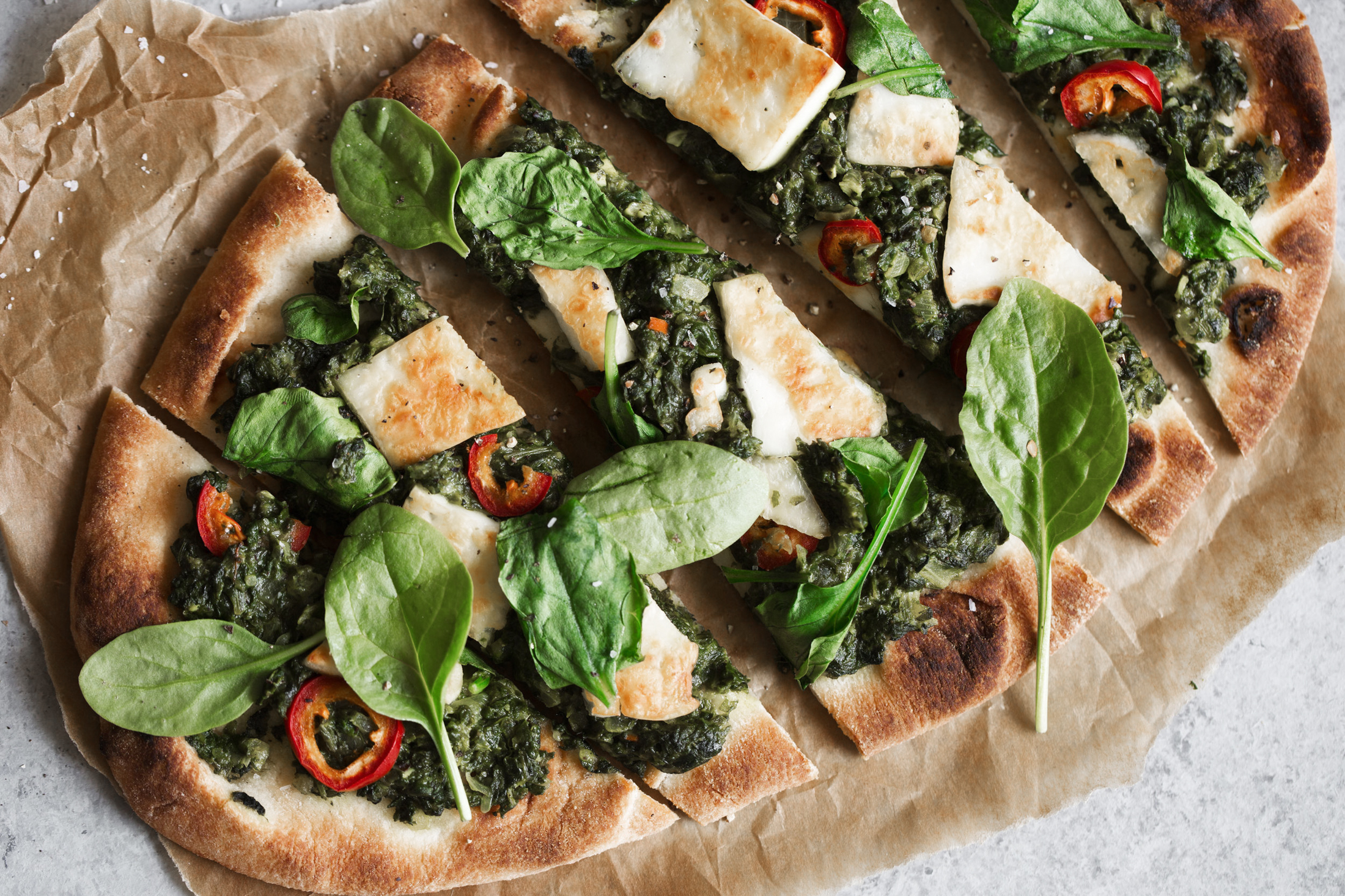 saag paneer pizza slices closeup