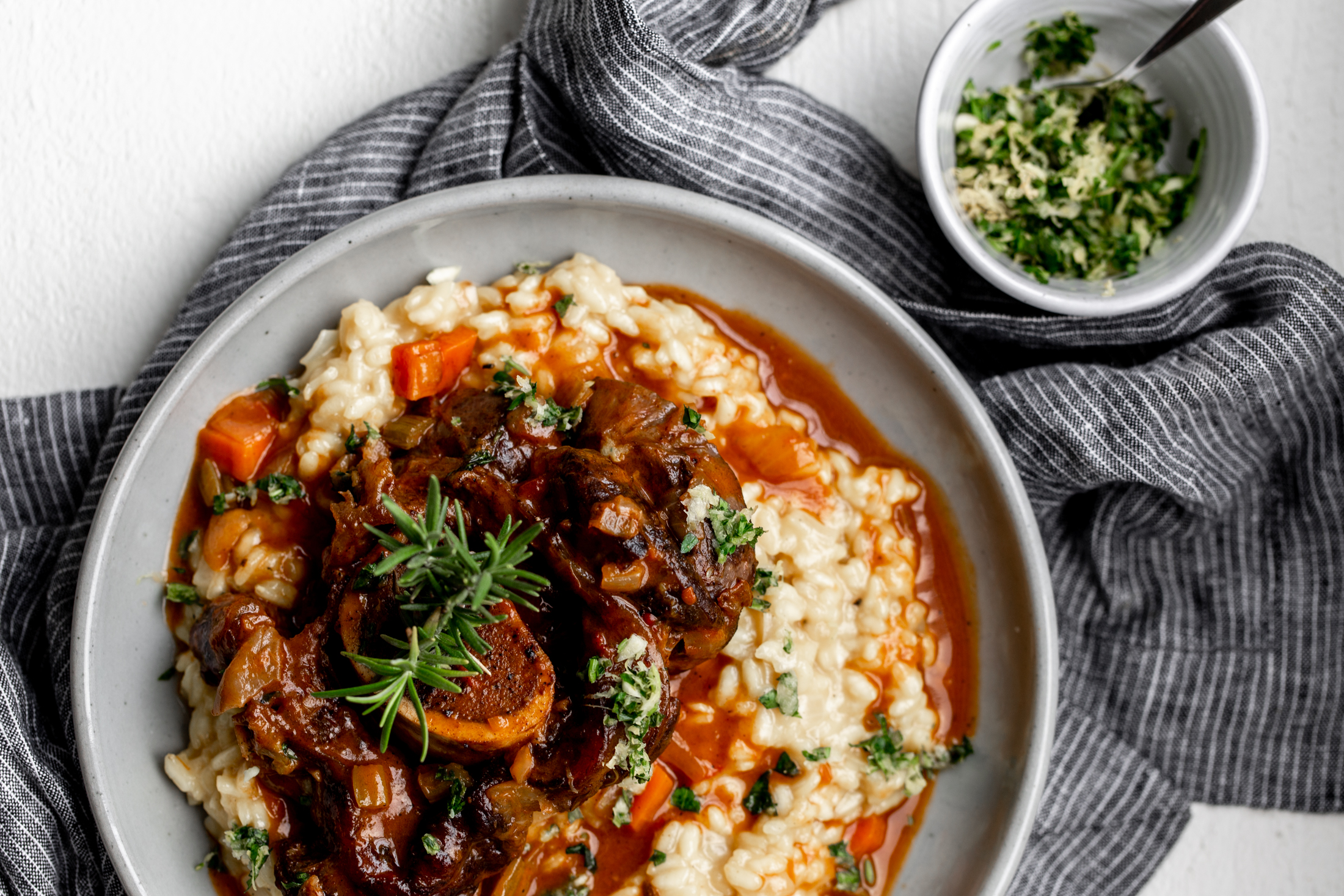 Veal Osso Buco recipe from cooking with cocktail rings over saffron risotto