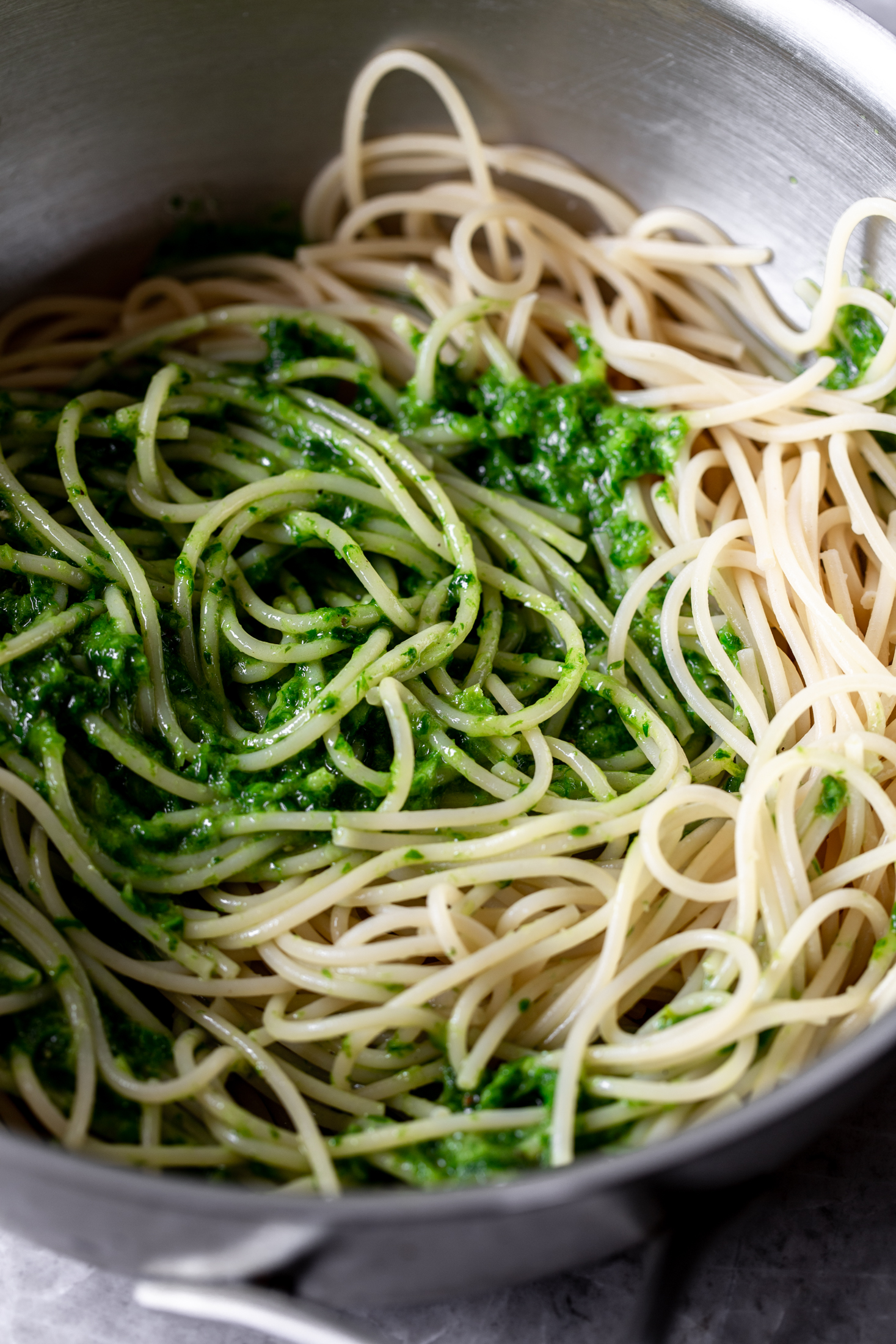 spaghetti with ramp pesto in pan ingredient shot