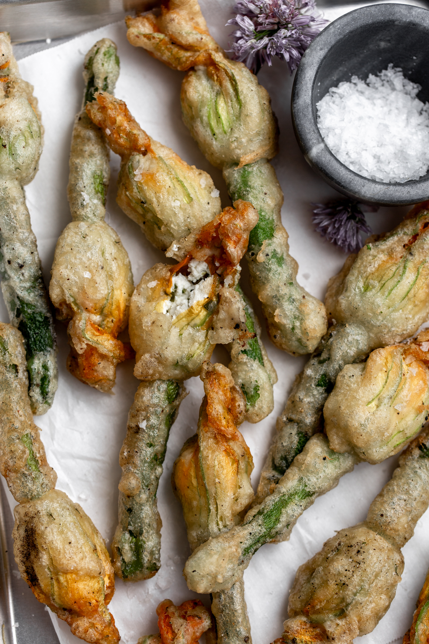 Fried Baby Zucchini with Ricotta Stuffed Squash Blossoms  cooking with cocktail rings closeup