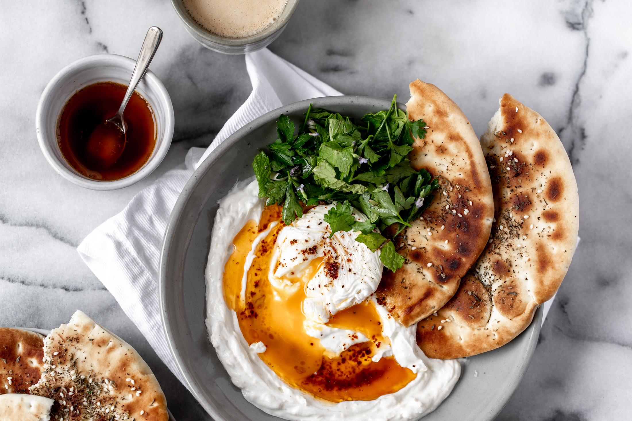 Turkish Savory Yogurt with Poached Eggs recipe from cooking with cocktail rings