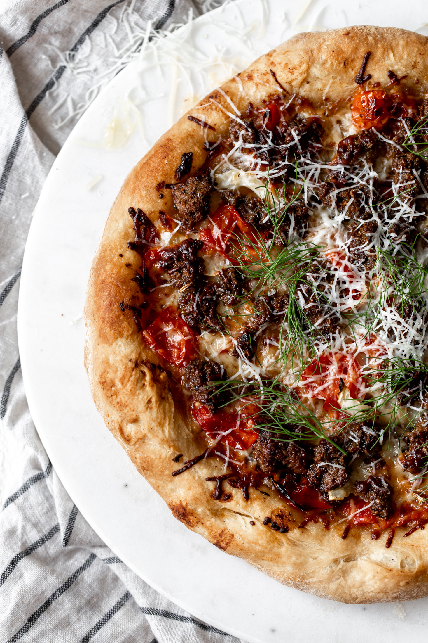 American Lamb Sausage Pizza with Confit Tomatoes and Fennelrecipe from Cooking with Cocktail Rings
