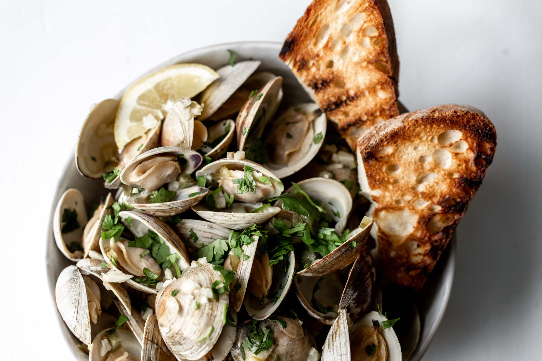Clams in White Wine Sauce with Serrano Garlic Butter and Grilled Bread recipe from cooking with cocktail rings