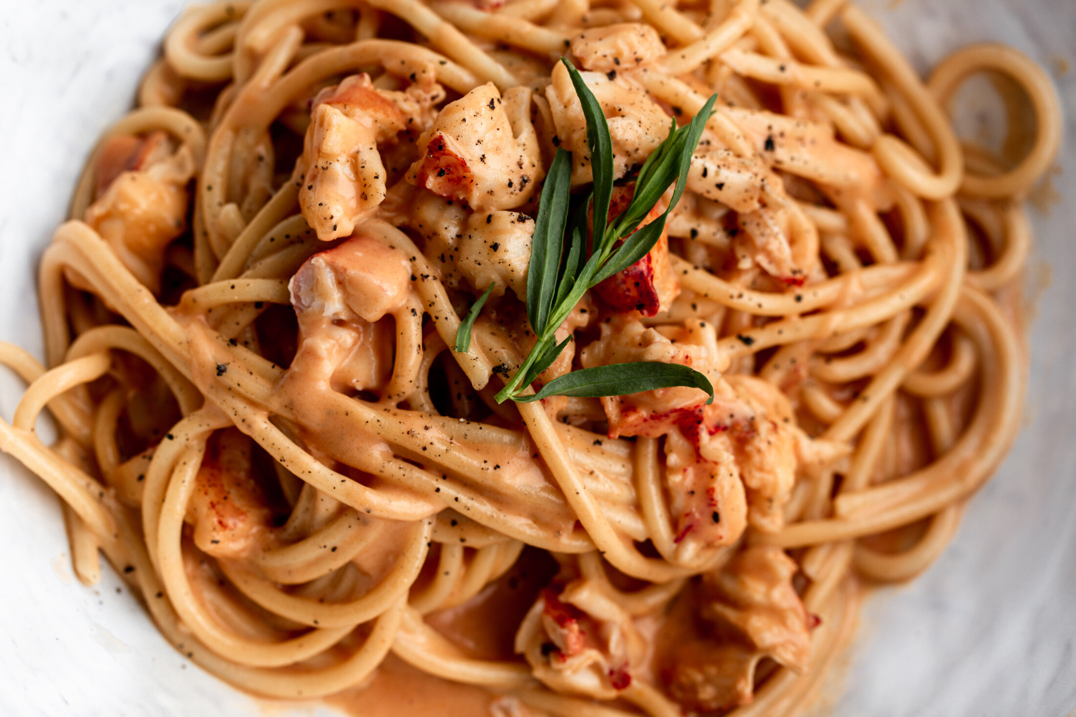 Creamy Lobster Pasta Cooking With Cocktail Rings