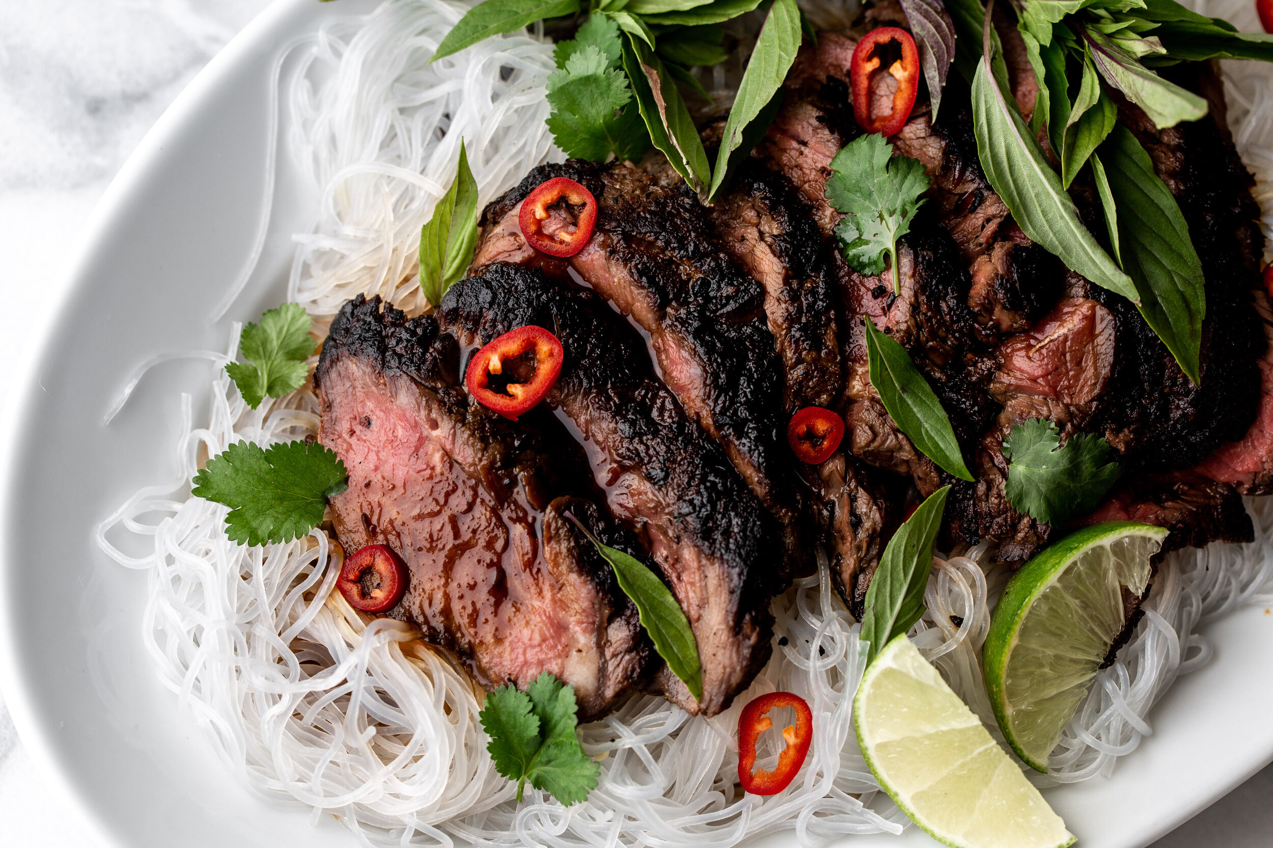 Thai Lime Beef Over Bean Thread Noodles Cooking With Cocktail Rings