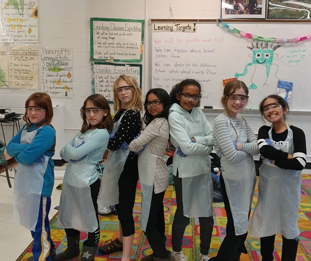 "Look at this picture! How cool is this? Another awesome #girlsinSTEM lesson at @bancroftdc. I heard ""I want to be a #chemist!"" and ""I want to be an #engineer!"" today. They were really excited to be wearing their personal protective equipment today for our lesson on #macronutrients. Clearly they mean business. #FiLS ##STEMeducation #livelearnshare #safetygoggles #gloves"