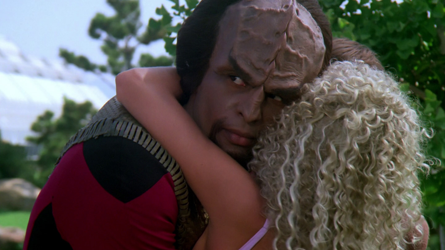"""Lt. Worf is embraced by Rivan. The feeling is NOT mutual."""""""