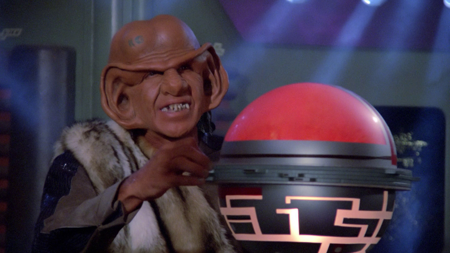 DaiMon Bok (Frank Corsentino) manipulates Picard's memories using an illegal Ferengi device.