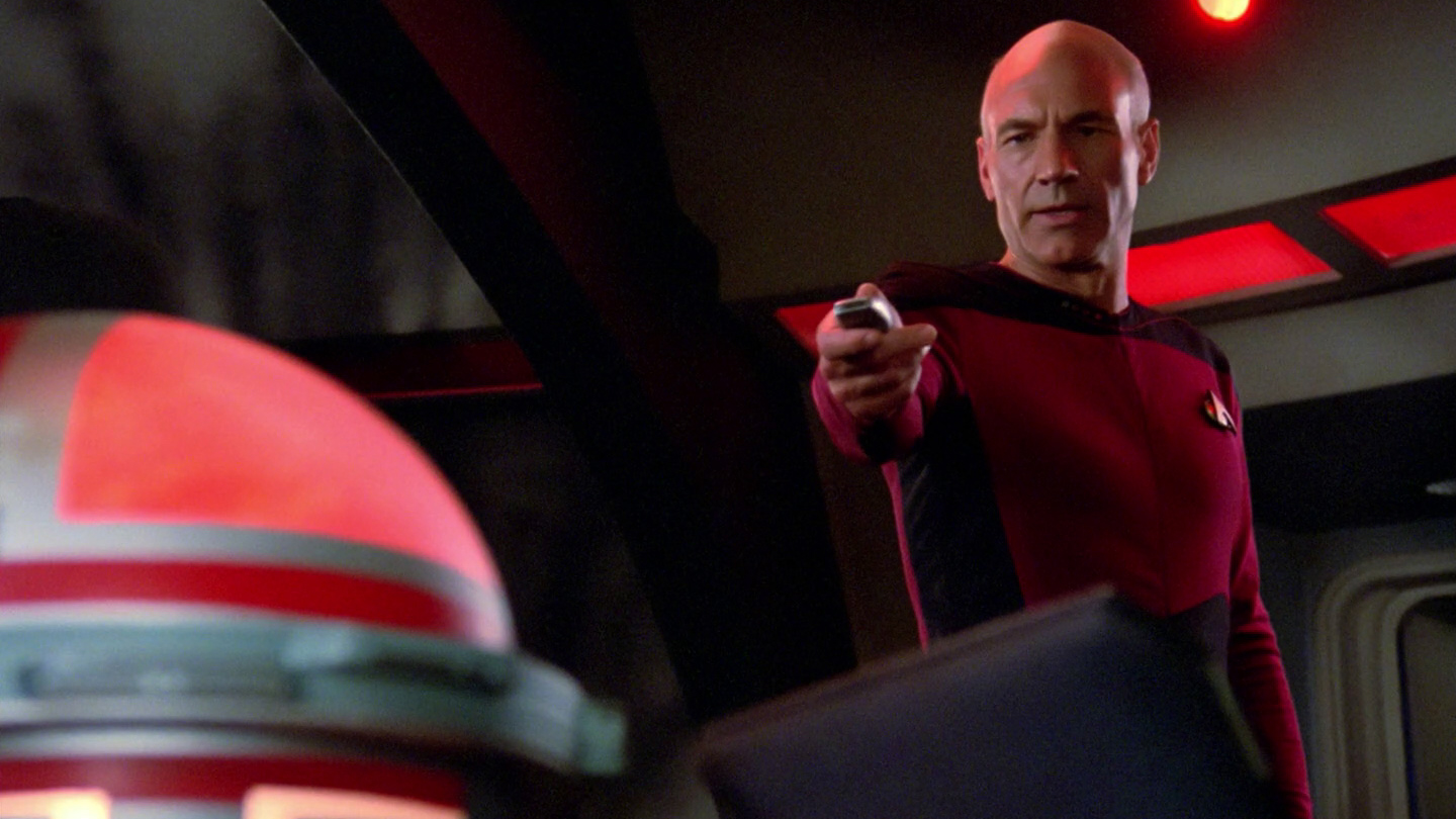 Picard struggles to destroy the Ferengi mind probe.