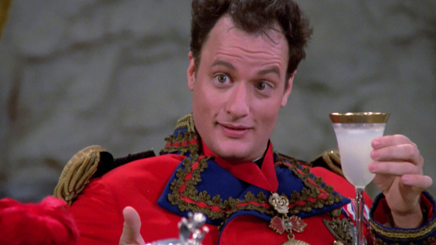 The trickster Q (John DeLancie) explains the rules of his game.