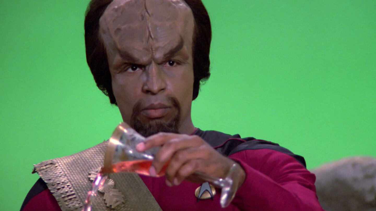 """Drink not with thine enemy…the rigid Klingon code."" Worf (Michael Dorn) refuses Q's offer of libation."