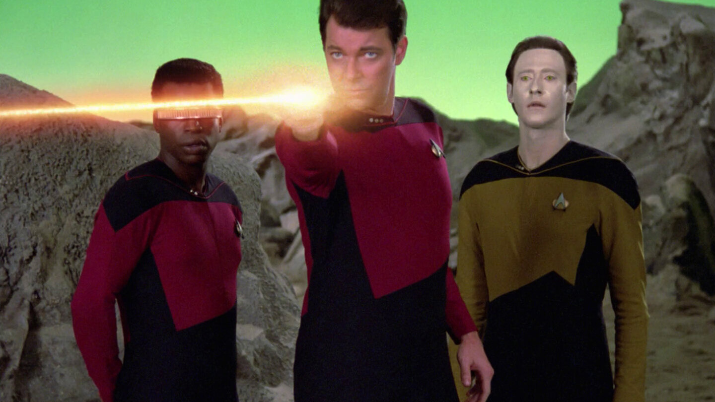 """Those aren't muskets."" LaForge (LeVar Burton), Riker (Jonathan Frakes) and Data (Brent Spiner) face off against the aliens created from Q's imagination."