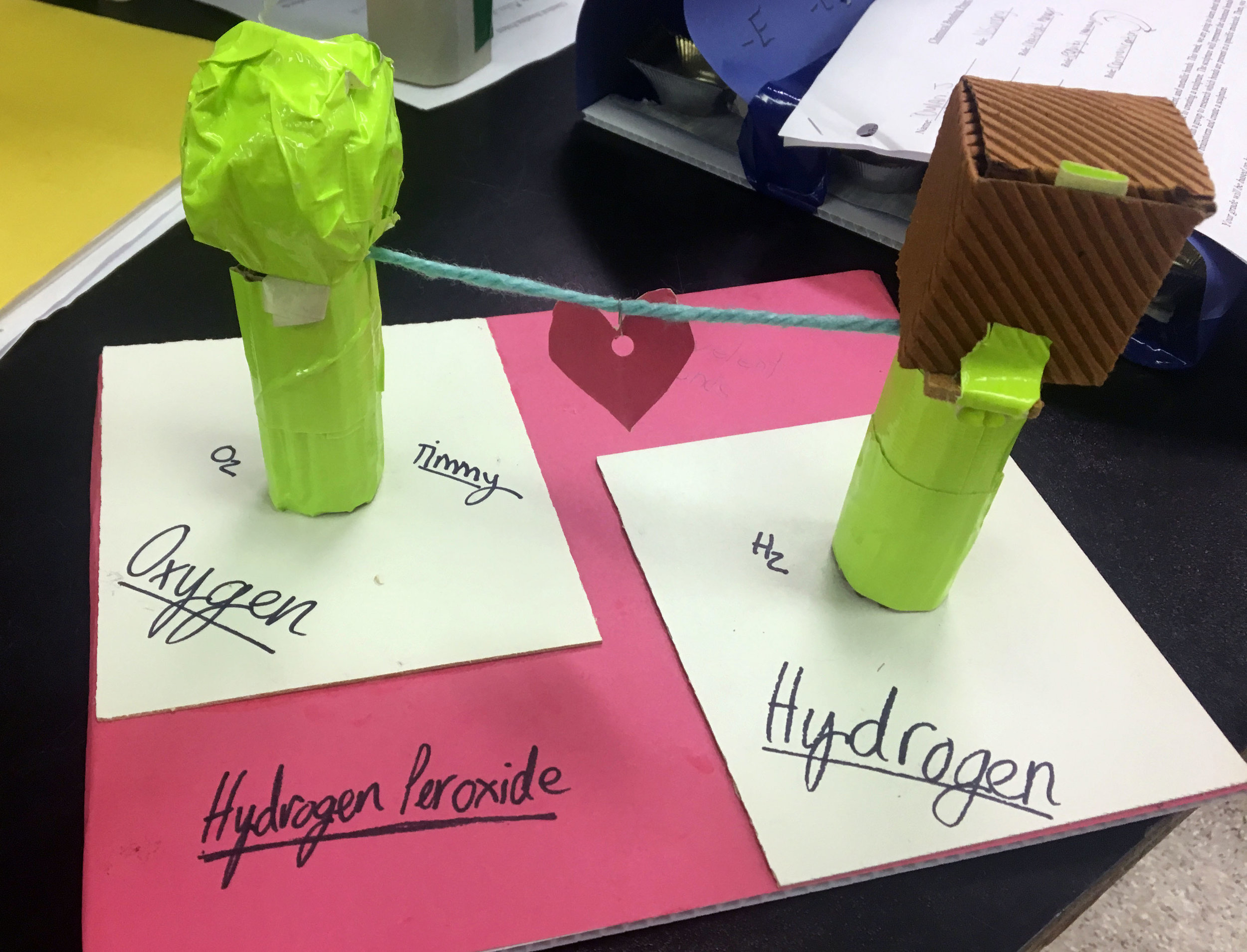 Students used recycled materials to create a sculpture representing the chemical bonds present in hydrogen peroxide.