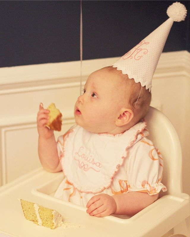 She was very serious about eating that cake 😂 Loved her little bib and birthday hat from @preppiepeonie 😍