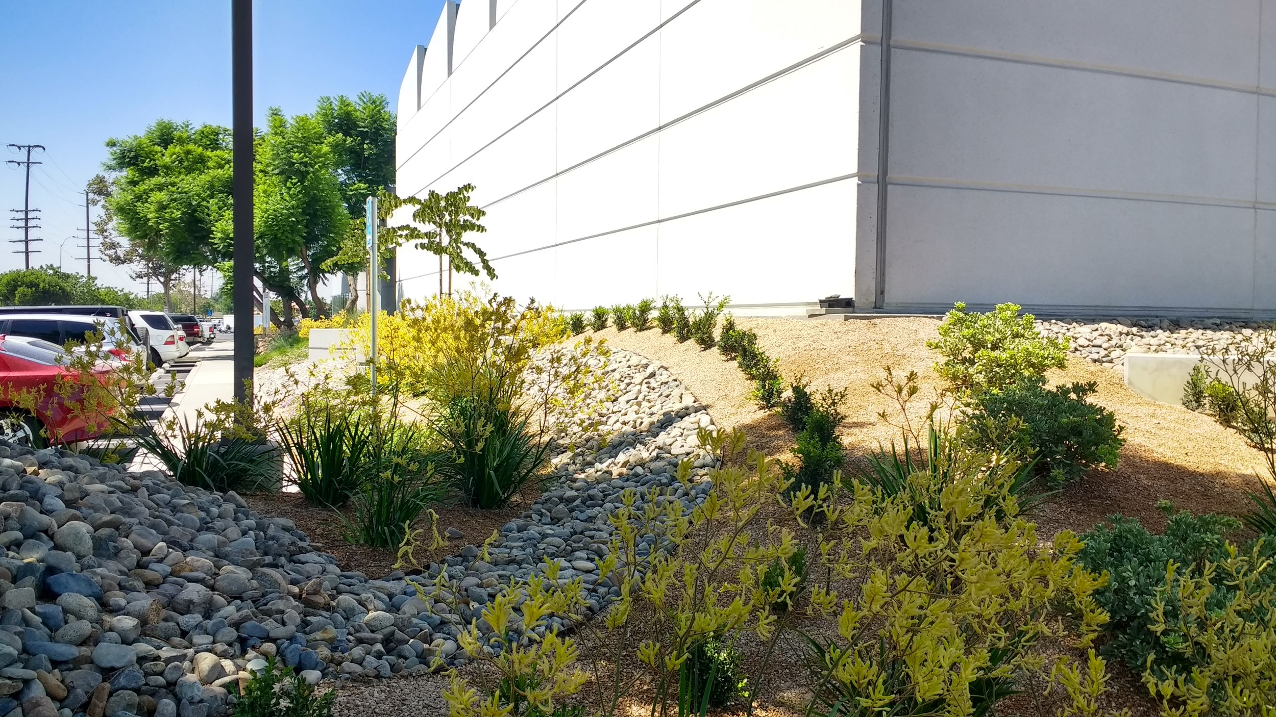 A fabric of landscape materials designed to integrate with the modern basket weave of the new parking structure. The landscape design is a complex system of layers and patterns representing the city and its complexity.