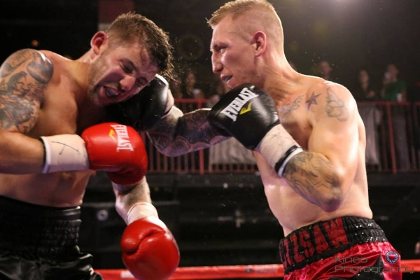 """Portland Boxing Club's Casey """"Buzzsaw"""" Kramlich (right) lands a blow to Greg Vendetti (left) at the House of Blues in Boston on September 30, 2017.  Photo courtesy Kineo Photography."""