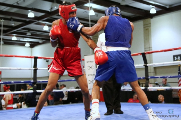 Portland Boxing Club's Josniel Castro (right, blue trunks) at the second round of the USA Boxing Eastern Elite Qualifiers in Chattanooga, TN.  Photo courtesy Kineo Photography.