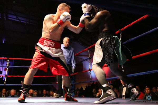 Portland Boxing Club's Jason Quirk (left, red trunks) at the Portland Expo on November 11, 2017.  Photo courtesy Kineo Photography.