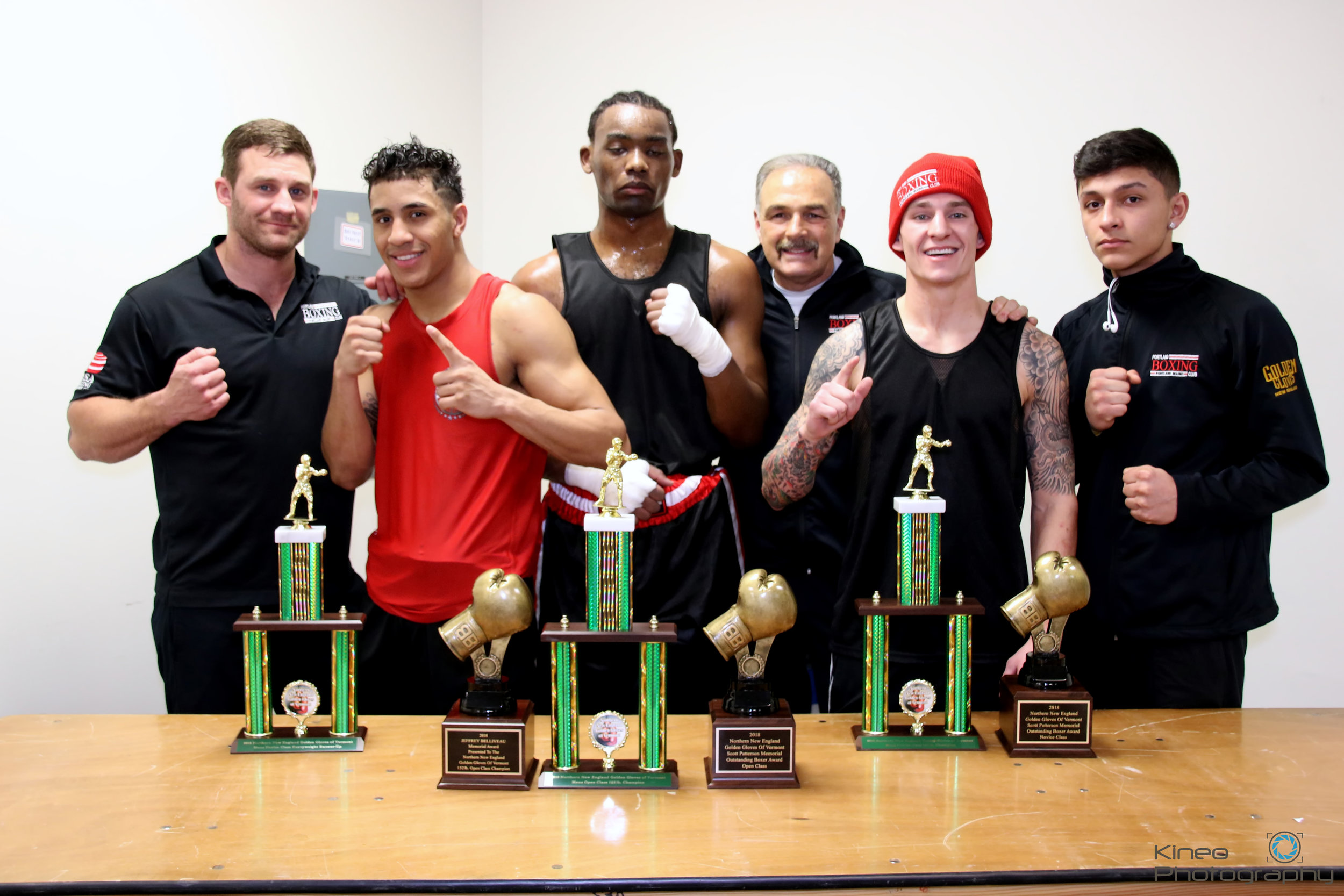 Portland Boxing Club's coach Ivan Papkee, welterweight Josniel Castro, heavyweight Mario Wilbor, head coach Bobby Russo, light welterweight Nathan Nappi and light welterweight Anthony Riga at the Northern New England Golden Gloves in Essex Jct., VT on February 3, 2018.