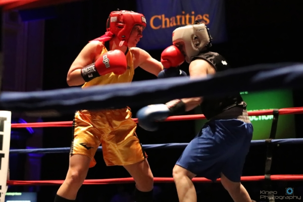 Portland Boxing Club's Lindsay (Kyajohnian) Francois (left) and Ashleigh Moore (right) at the New England Golden Gloves Championship Finals at the Lowell Memorial Auditorium in Lowell, MA on February 22, 2018.  Photo courtesy Kineo Photography.