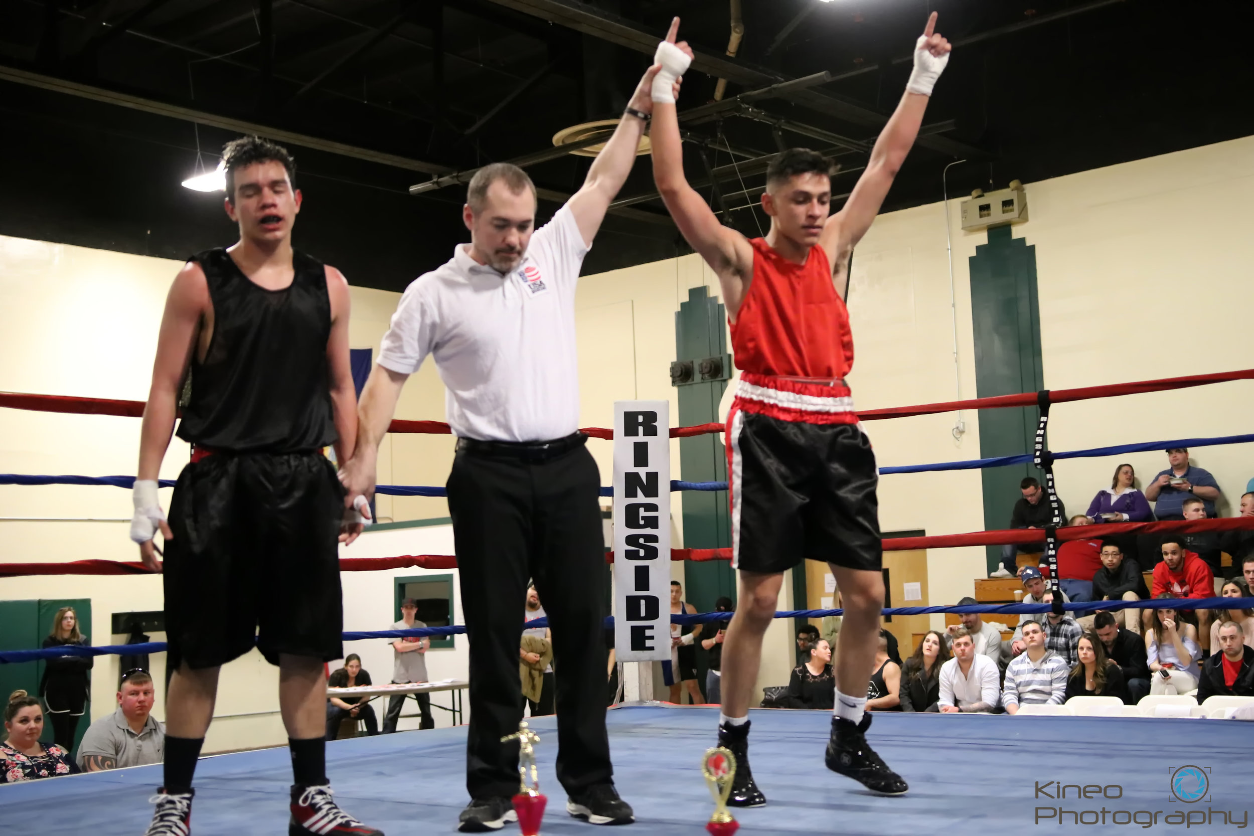 Portland Boxing Club's Anthony Riga, of South Portland, ME, (right) defeats Axel Cujantes, of Stamford, CT, at Knock Out Cancer Boxing Night at the Windsor Recreation Center in Windsor, VT.  Photo courtesy Kineo Photography.