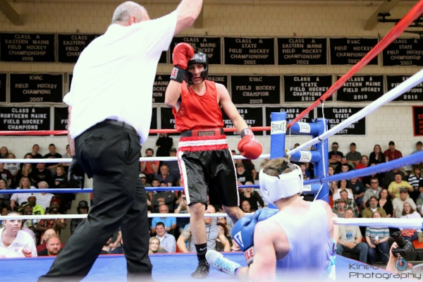 Portland Boxing Club's Anthony Riga (center) landed a combination that sent Isaac Parker (right) to the canvas for a second time at the Skowhegan Pro-Am show on April 28.  Photo courtesy Kineo Photography.