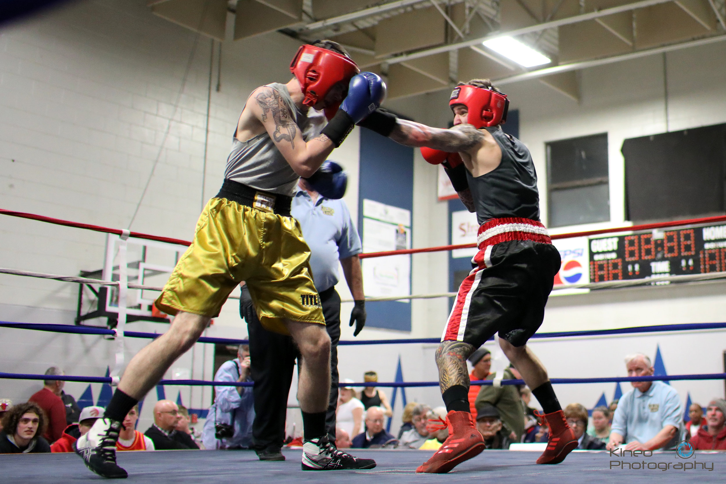Portland Boxing Club's light welterweight (141 lbs) Nate Nappi (right) lands a jab to Derek Carlbers at the Northern New England Golden Gloves Finals on January 26, 2019. Photo courtesy Kineo Photography.